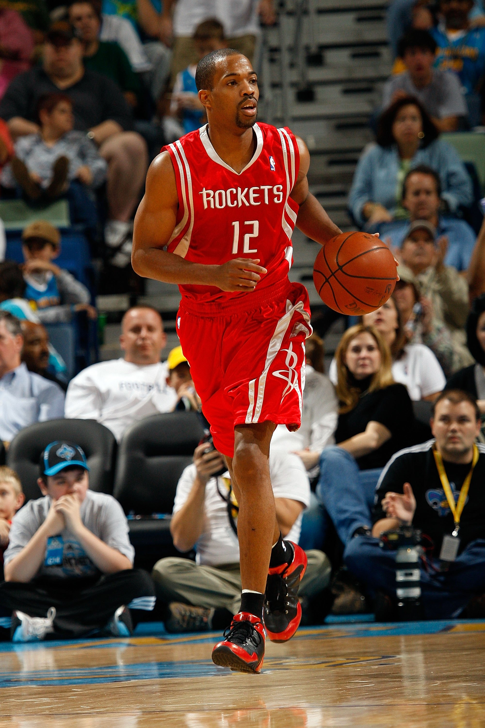 NEW ORLEANS - DECEMBER 26:  Rafer Alston #12 of the Houston Rockets dribbles the ball during the game against the New Orleans Hornets on December 26, 2008 at the New Orleans Arena in New Orleans, Louisiana.  NOTE TO USER: User expressly acknowledges and a