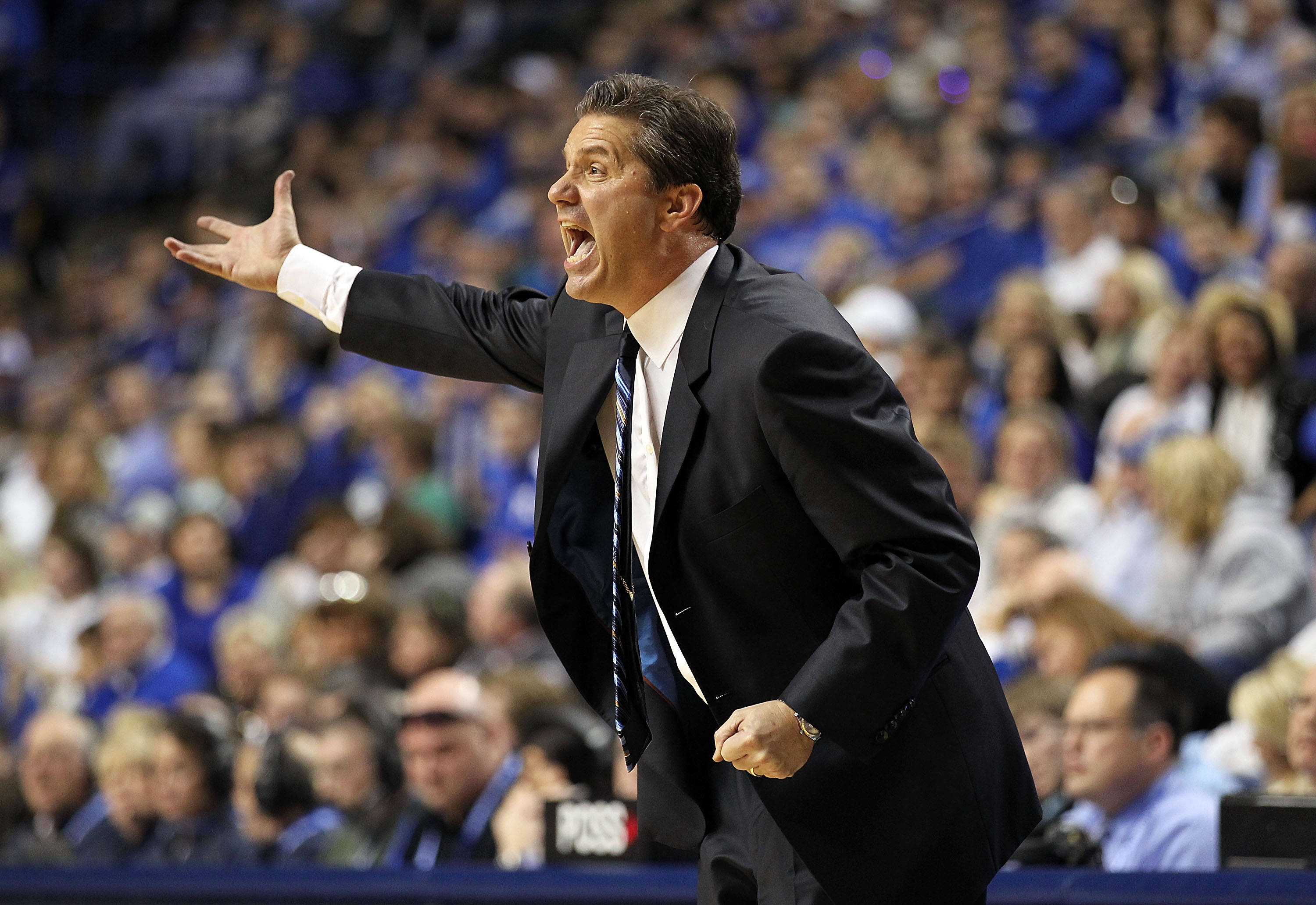 LEXINGTON, KY - JANUARY 29:  John Calipari the Head Coach of the Kentucky Wildcats gives instructions to his team during the SEC game against the Georgia Bulldogs at Rupp Arena on January 29, 2011 in Lexington, Kentucky. Kentucky won 66-60.  (Photo by And