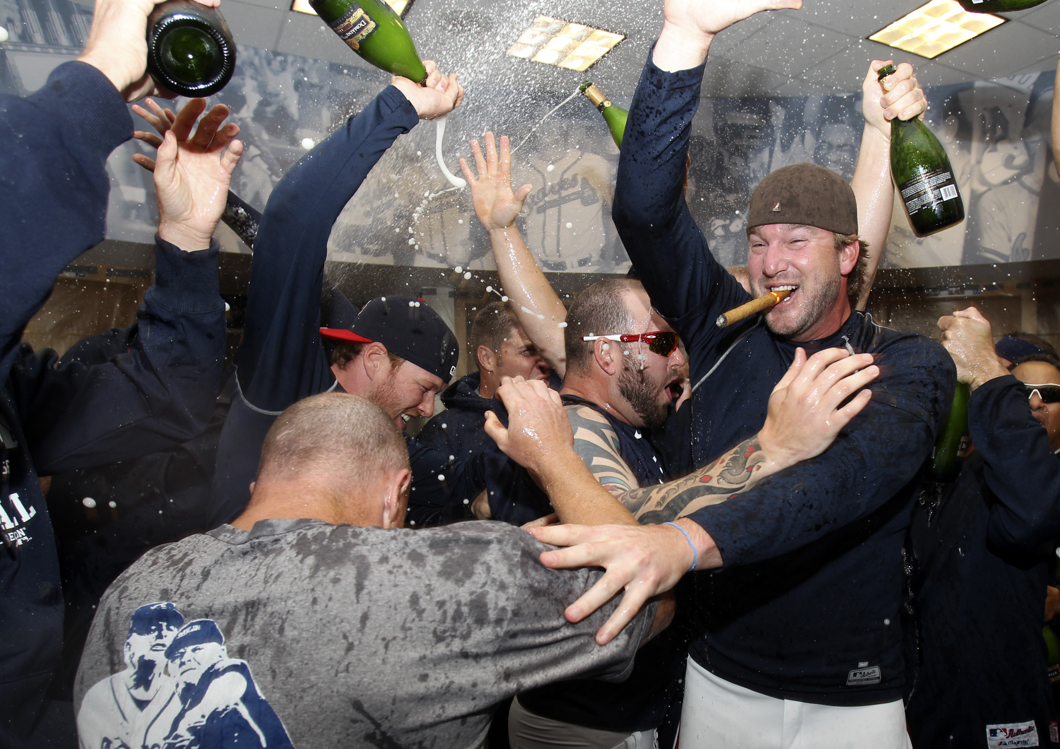 ATLANTA - OCTOBER 03:  Pitcher Derek Lowe #32 of the Atlanta Braves (right)celebrates with teammates after the Braves clinch the National League Wildcard after the game against the Philadelphia Phillies at Turner Field on October 3, 2010 in Atlanta, Georg