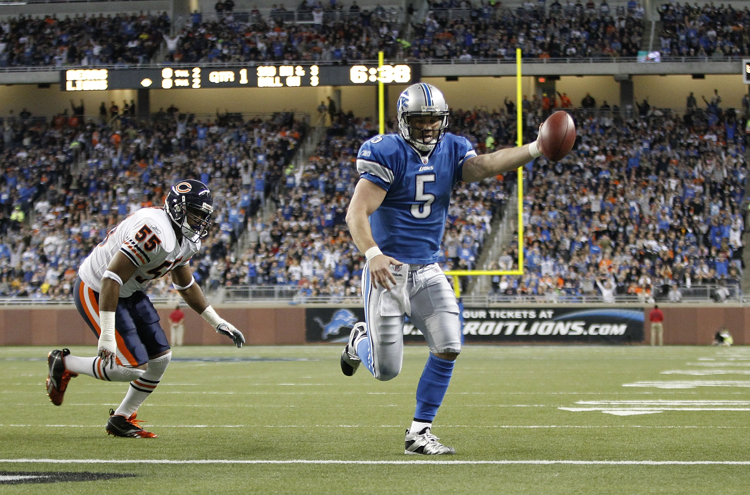 DETROIT - DECEMBER 05: Drew Stanton #5 of the Detroit Lions runs three yards for a first quarter touchdown as Lance Briggs #55 of the Chicago Bears gives chase during the game at Ford Field on December 5, 2010 in Detroit, Michigan.  (Photo by Leon Halip/G