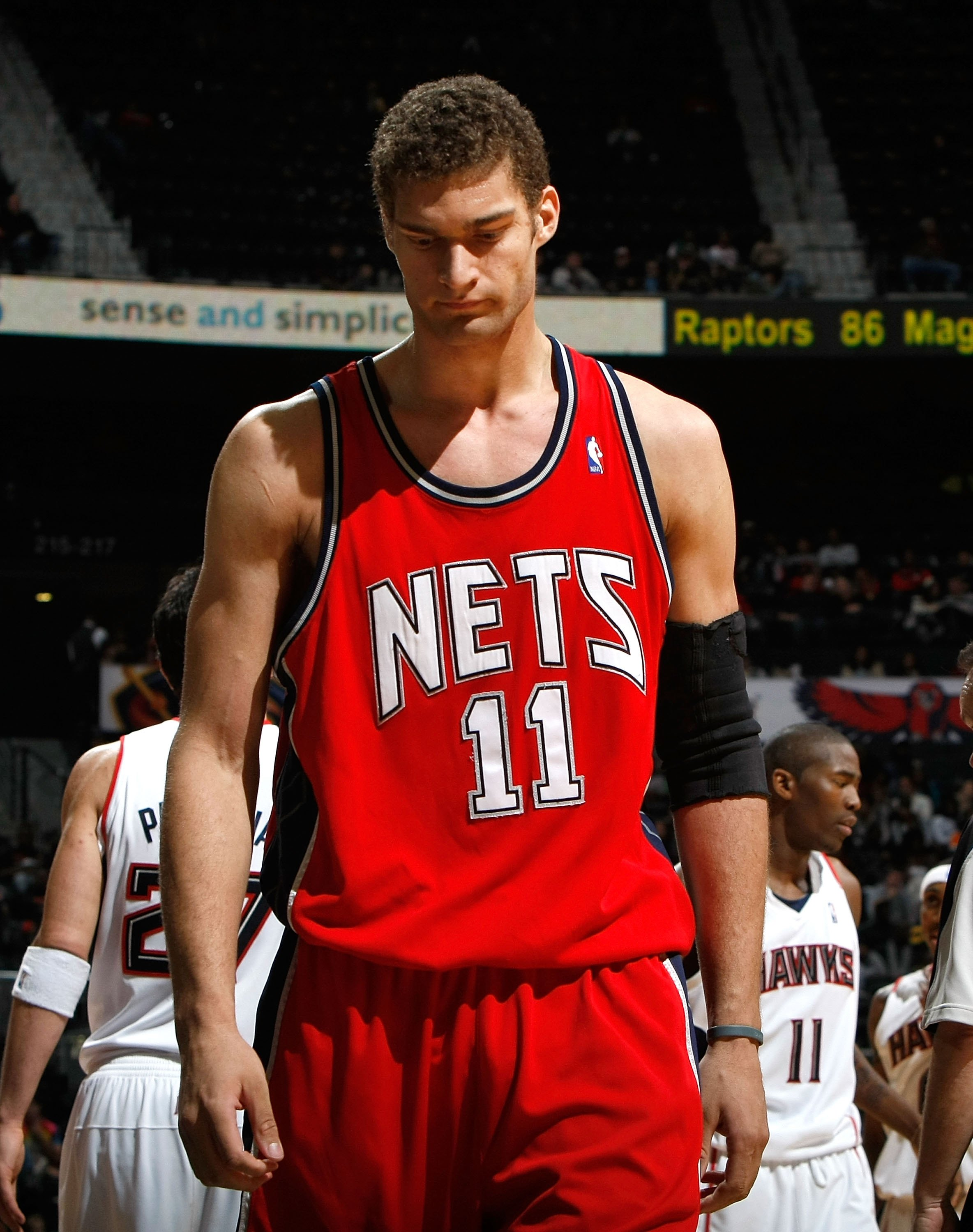 ATLANTA - JANUARY 06:  Brook Lopez #11 of the New Jersey Nets against the Atlanta Hawks at Philips Arena on January 6, 2010 in Atlanta, Georgia.  NOTE TO USER: User expressly acknowledges and agrees that, by downloading and/or using this Photograph, User