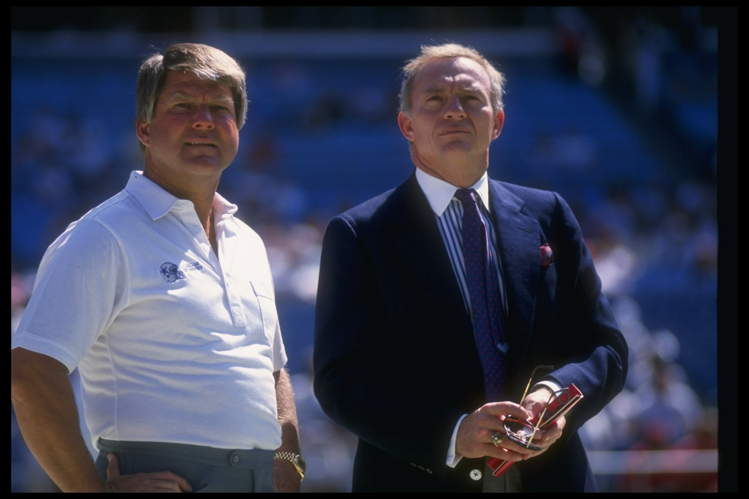 17 Sep 1989:  Dallas Cowboys head coach Jimmy Johnson (left) and owner Jerry Jones look on during a game against the Atlanta Falcons at Fulton County Stadium in Atlanta, Georgia.  The Falcons won the game, 27-21. Mandatory Credit: Allen Dean Steele  /Alls