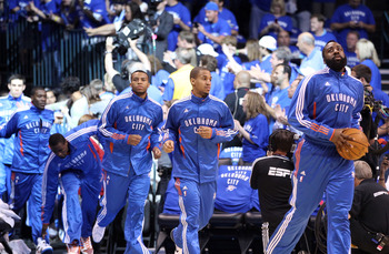 OKLAHOMA CITY, OK - MAY 23:  (R-L) James Harden #13, Eric Maynor #6 and Daequan Cook #14 run out of the tunnel before taking on the Dallas Mavericks in Game Four of the Western Conference Finals during the 2011 NBA Playoffs at Oklahoma City Arena on May 2