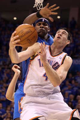 OKLAHOMA CITY, OK - MAY 23:  Nick Collison #4 of the Oklahoma City Thunder looks to shoot against Brendan Haywood #33 of the Dallas Mavericks in the second half in Game Four of the Western Conference Finals during the 2011 NBA Playoffs at Oklahoma City Ar