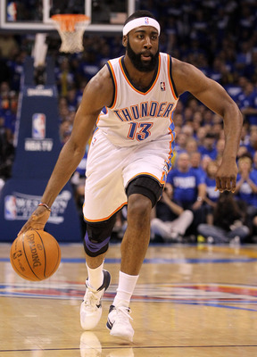OKLAHOMA CITY, OK - MAY 21:  James Harden #13 of the Oklahoma City Thunder moves the ball while taking on the Dallas Mavericks in Game Three of the Western Conference Finals during the 2011 NBA Playoffs at Oklahoma City Arena on May 21, 2011 in Oklahoma C