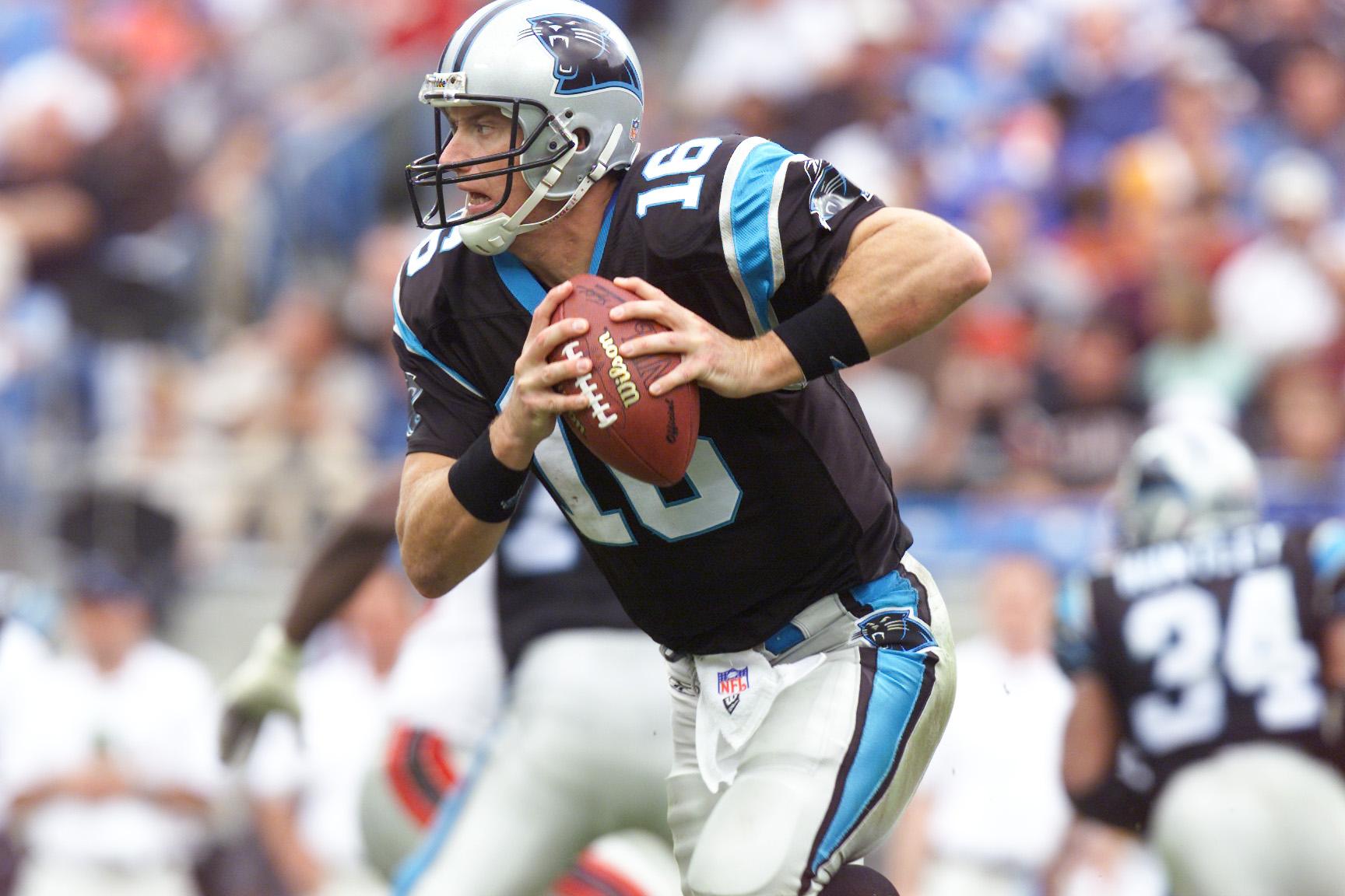 25 Nov 2001 : Chris Weinke of the Carolina Panthers runs with the ball against the Atlanta Falcons during the game at Ericsson Stadium in Charlotte, North Carolina. The Falcons won 10-7. DIGITAL IMAGE. Mandatory Credit: Craig Jones/Allsport