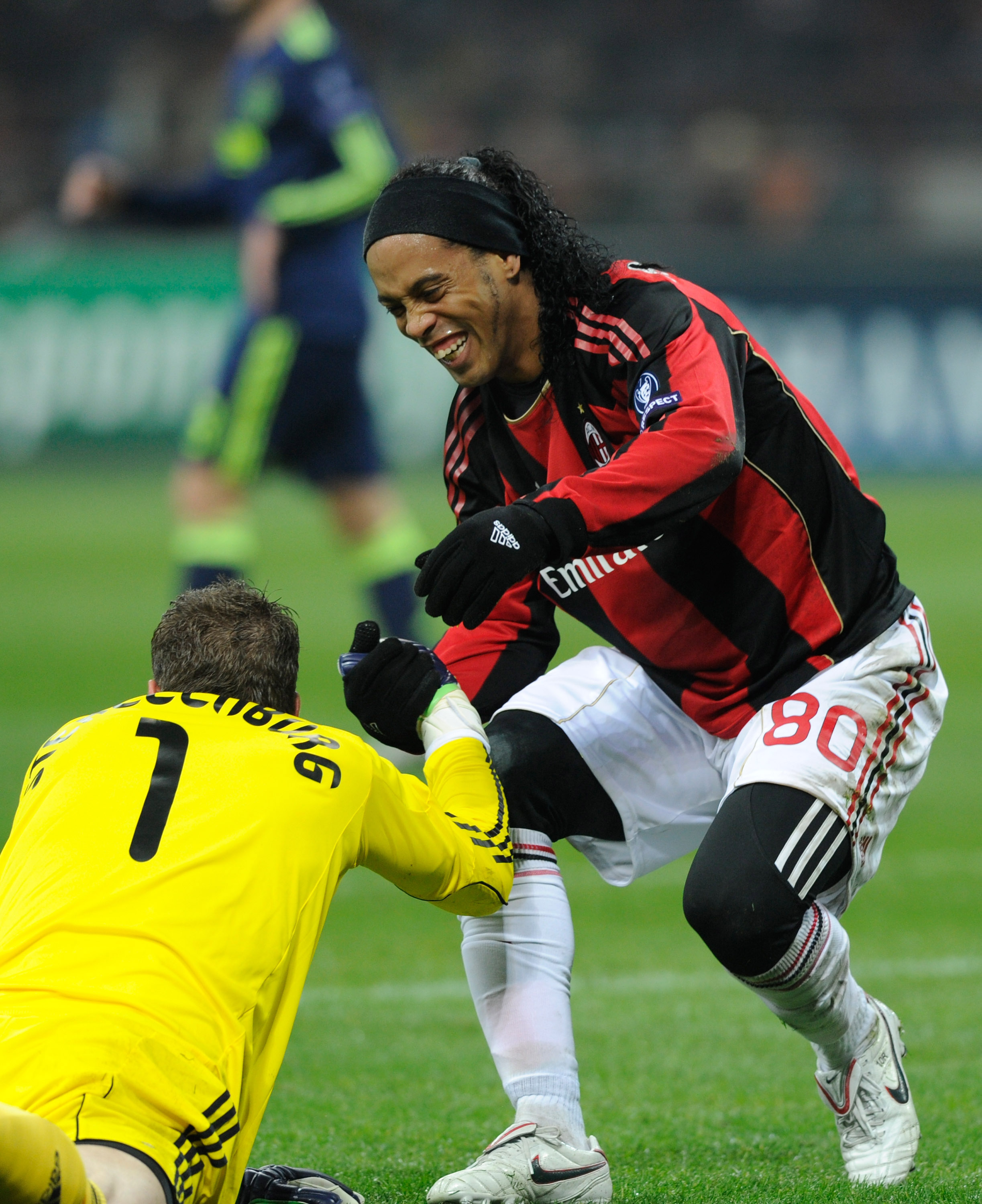 MILAN, ITALY - DECEMBER 08:  Maarten Stekelenburg of AFC Ajax is helped up by Ronaldinho of AC Milan during the UEFA Champions League Group G match between AC Milan and AFC Ajax at Stadio Giuseppe Meazza on December 8, 2010 in Milan, Italy.  (Photo by Cla