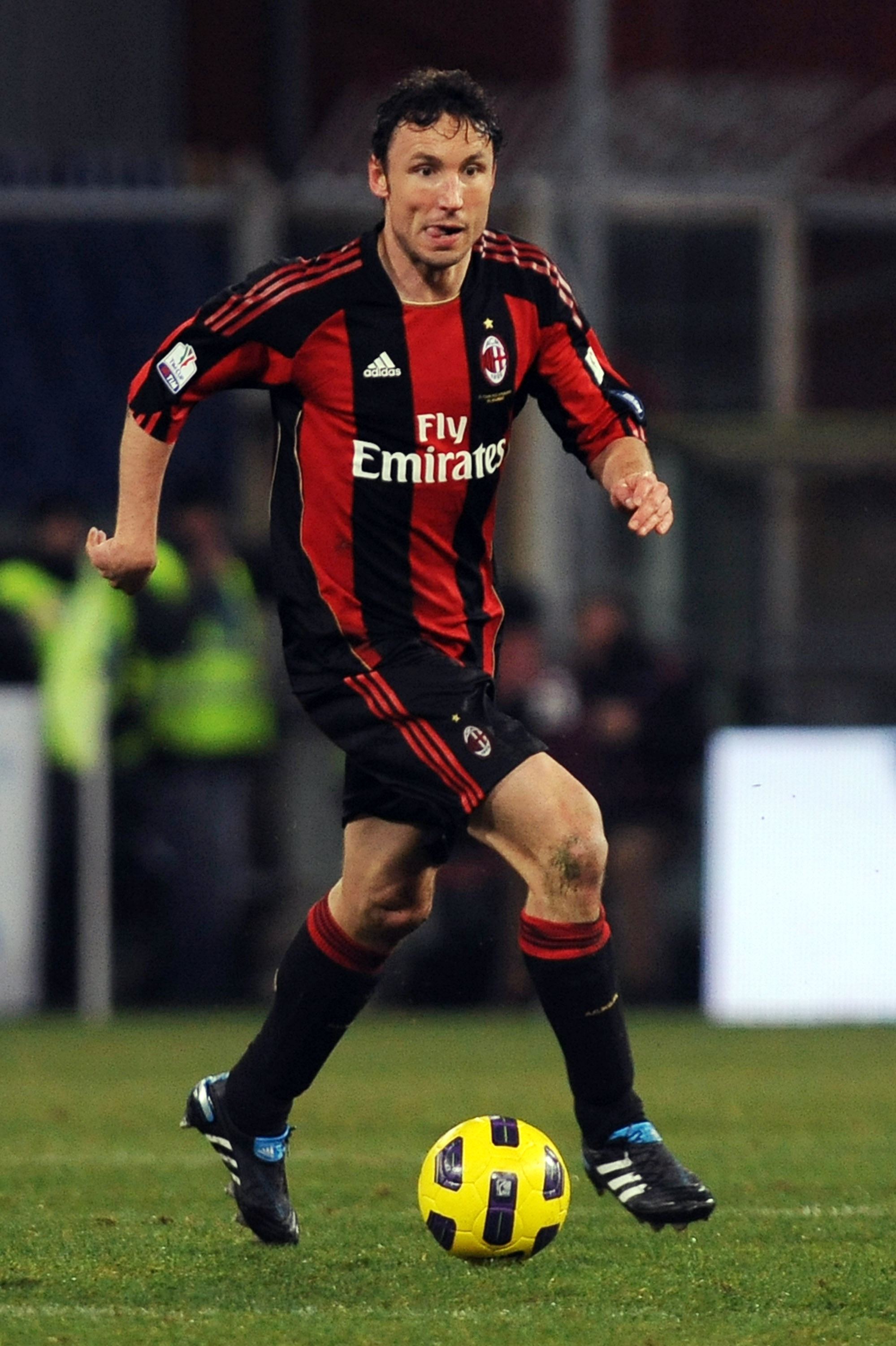 GENOA, ITALY - JANUARY 26:  Mark van Bommel of AC Milan in action during the Tim Cup match between UC Sampdoria and AC Milan at Luigi Ferraris Stadium on January 26, 2011 in Genoa, Italy.  (Photo by Valerio Pennicino/Getty Images)