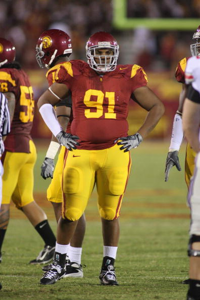 LOS ANGELES - SEPTEMBER 13:  Jurrell Casey #91 of the USC Trojans looks on against the Ohio State Buckeyes on September 13, 2008 at the Los Angeles Memorial Coliseum in Los Angeles, California.  USC won 35-3.  (Photo by Jeff Golden/Getty Images)
