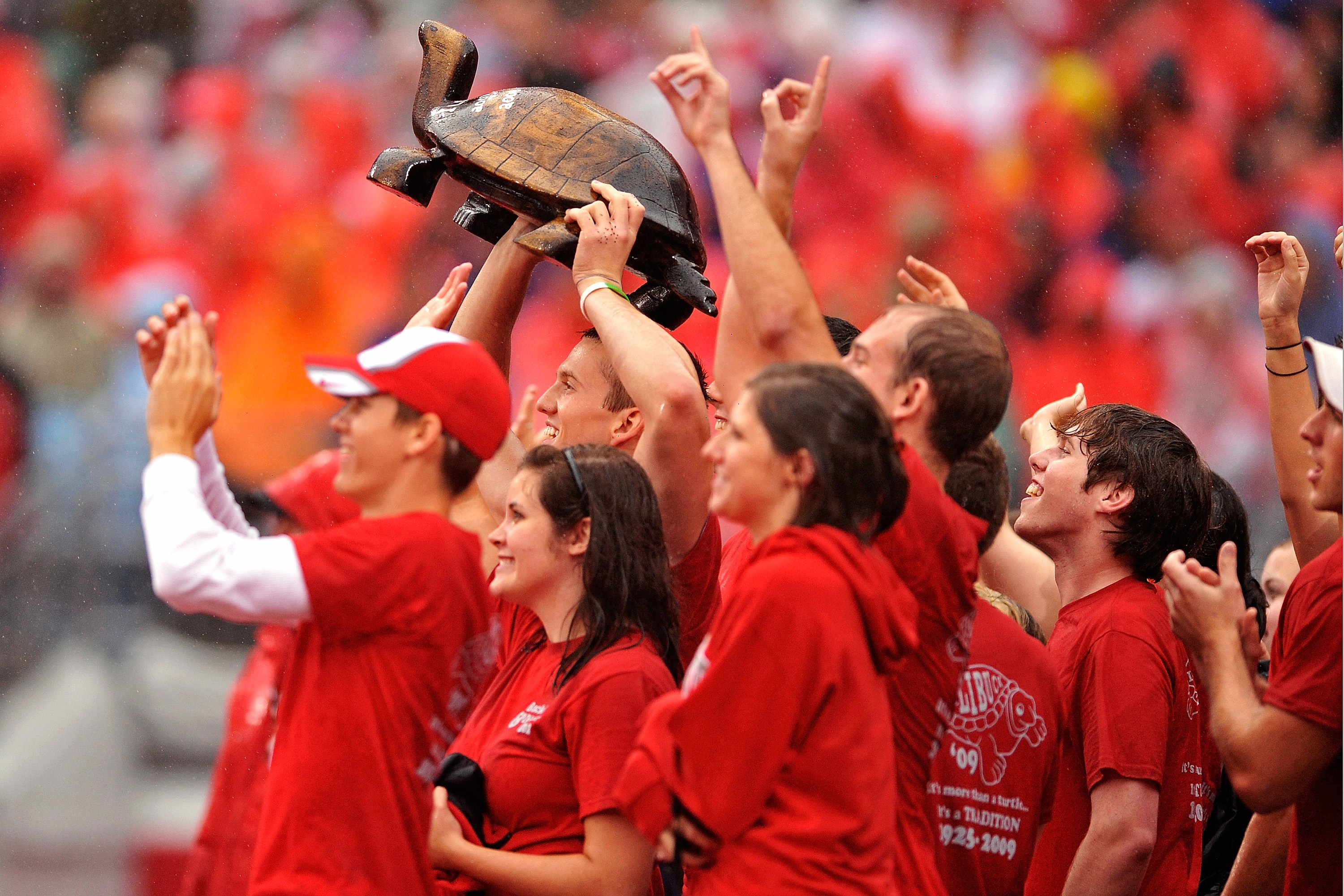 COLUMBUS, OH - SEPTEMBER 26:  Ohio State Buckeyes students hoist the Illibuck trophy during the game against the Illinois Fighting Illinois at Ohio Stadium on September 26, 2009 in Columbus, Ohio. The winner of the game gets to keep the trophy on campus u