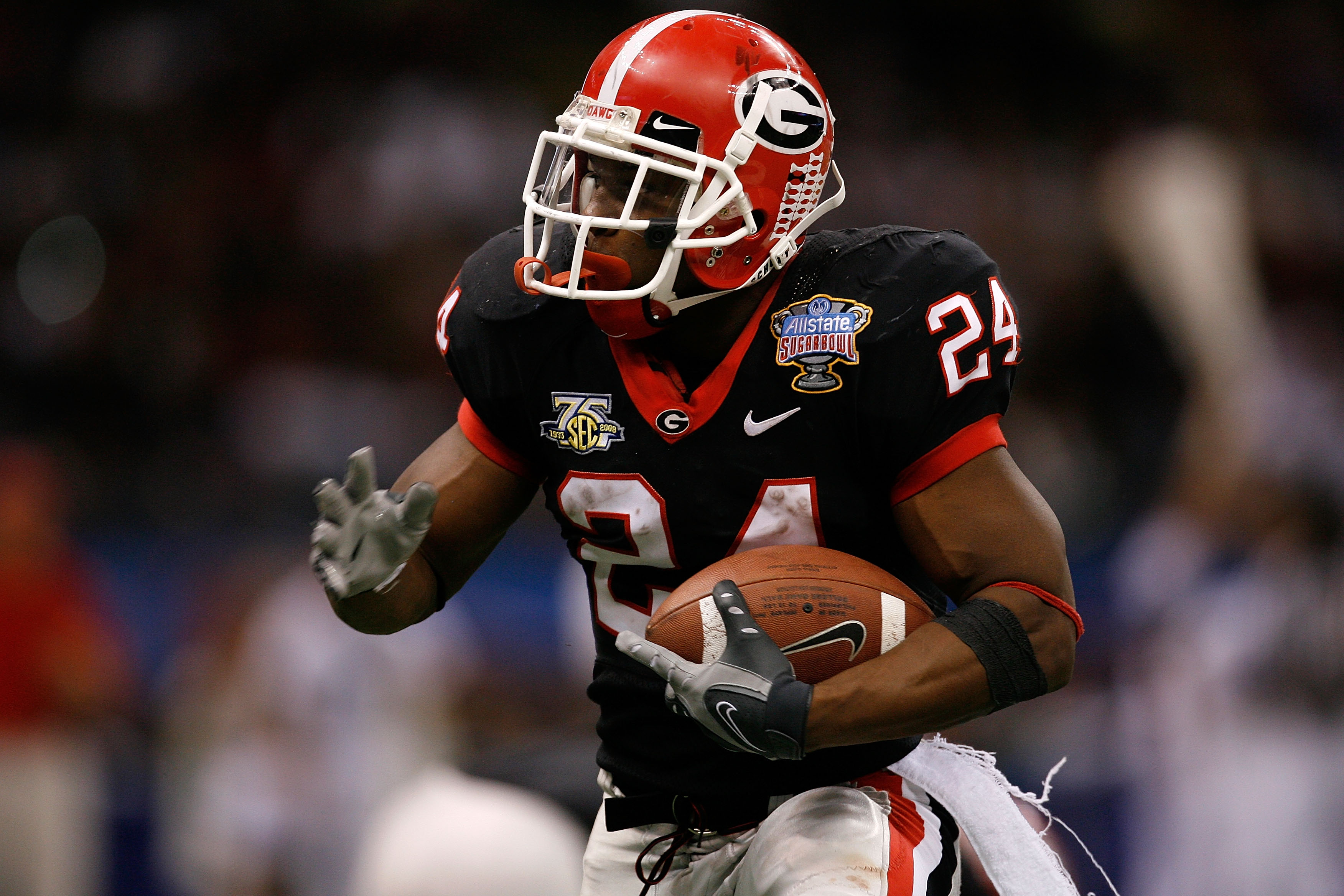 NEW ORLEANS - JANUARY 01:  Knowshon Moreno #24 of the Georgia Bulldogs runs the ball against the Hawai'i Warriors during the Allstate Sugar Bowl at the Louisiana Superdome on January 1, 2008 in New Orleans, Louisiana.  (Photo by Kevin C. Cox/Getty Images)