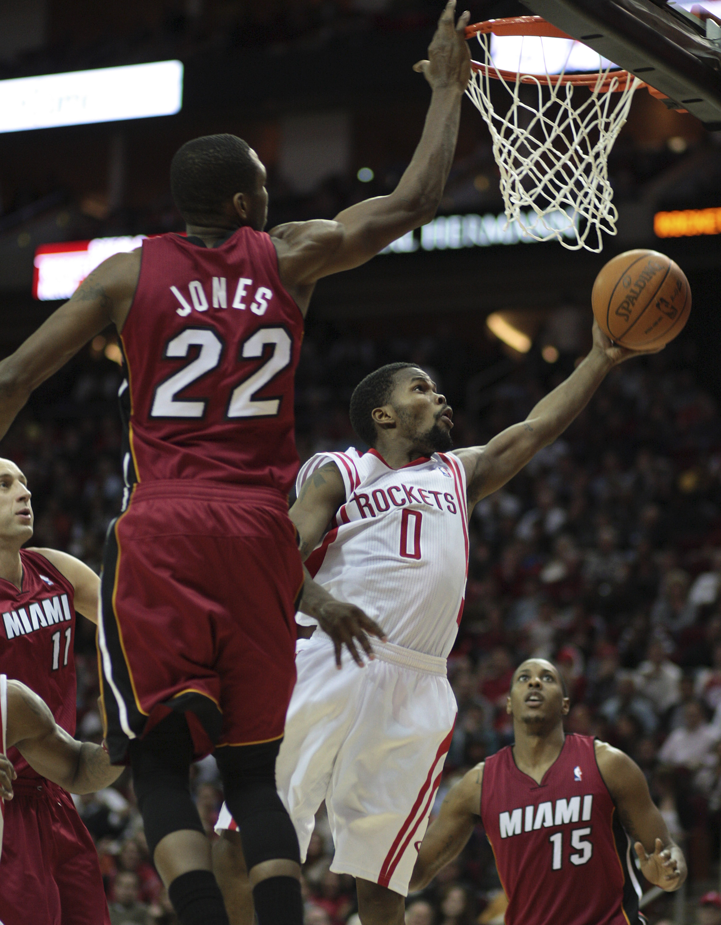 HOUSTON - DECEMBER 29: Aaron Brooks #0 of the Houston Rockets drives to the basket past James Jones #22 of the Miami Heat at Toyota Center on December 29, 2010 in Houston, Texas.  (Photo by Bob Levey/Getty Images)