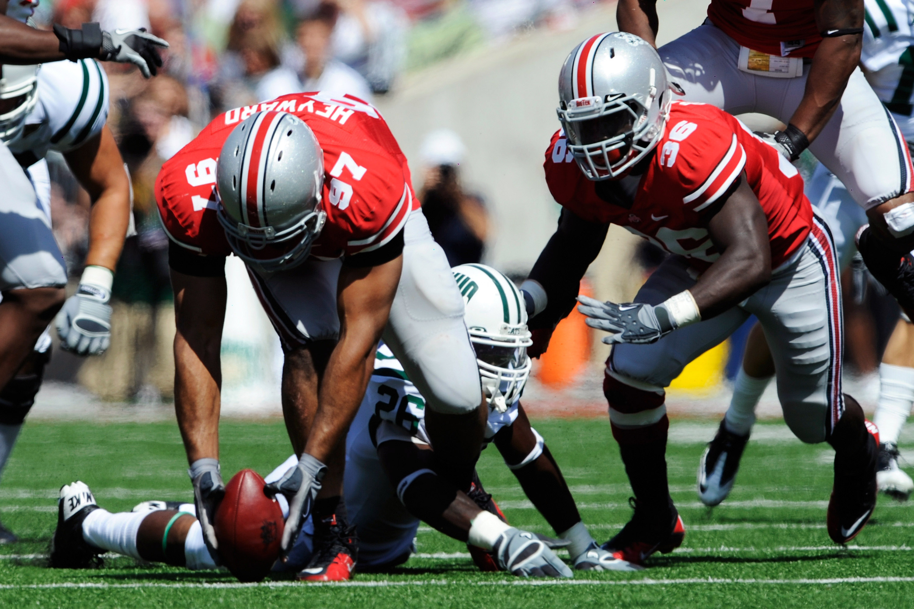 COLUMBUS, OH - SEPTEMBER 18:  Cameron Heyward #97 of the Ohio State Buckeyes picks up a fumble by Vince Davidson #26 of the Ohio Bobcats at Ohio Stadium on September 18, 2010 in Columbus, Ohio.  (Photo by Jamie Sabau/Getty Images)