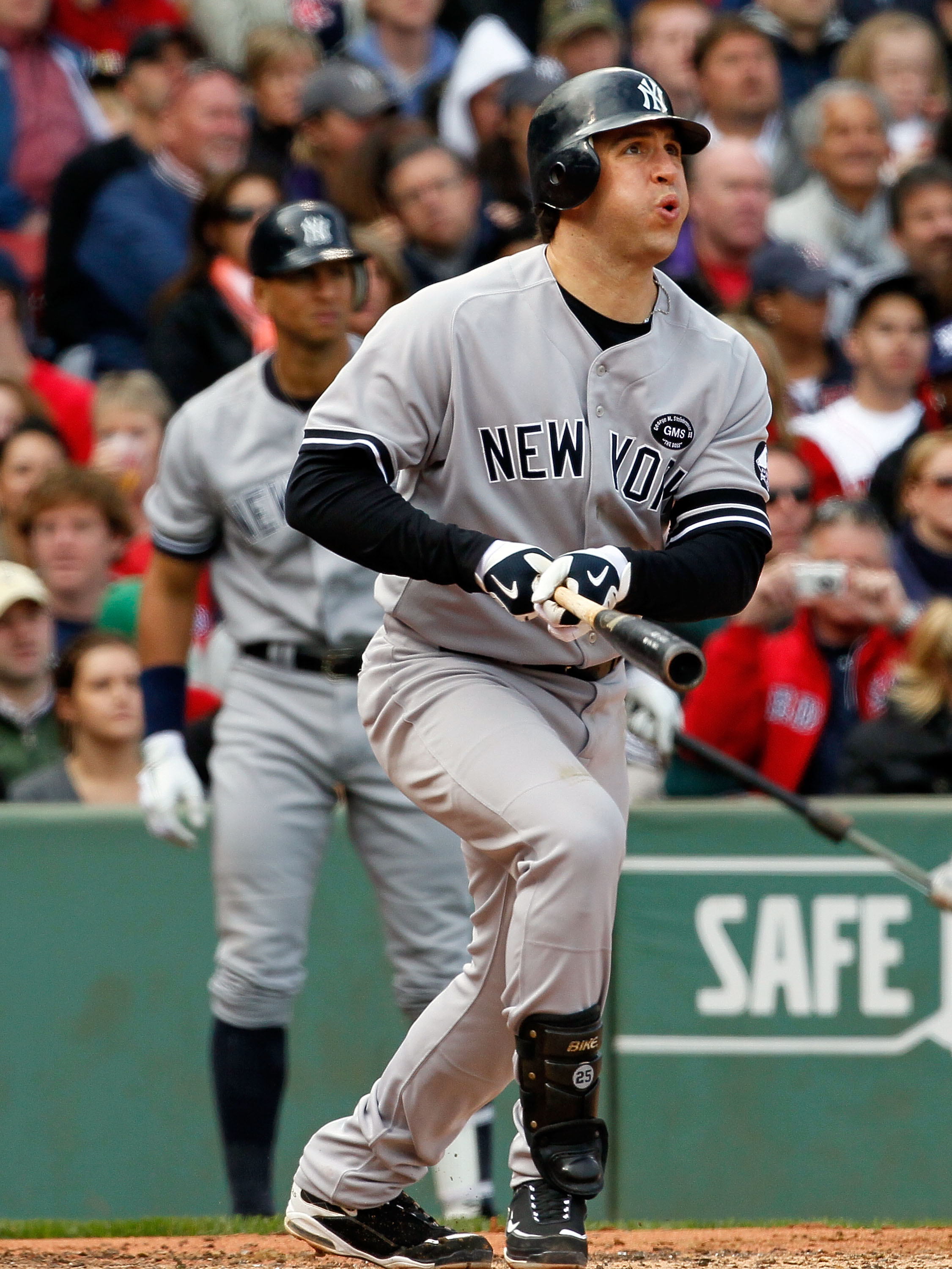 BOSTON - OCTOBER 3:  Mark Teixeira #25 of the New York Yankees watches the flight of a hit ball against the Boston Red Sox at Fenway Park October 3, 2010 in Boston, Massachusetts. (Photo by Jim Rogash/Getty Images)