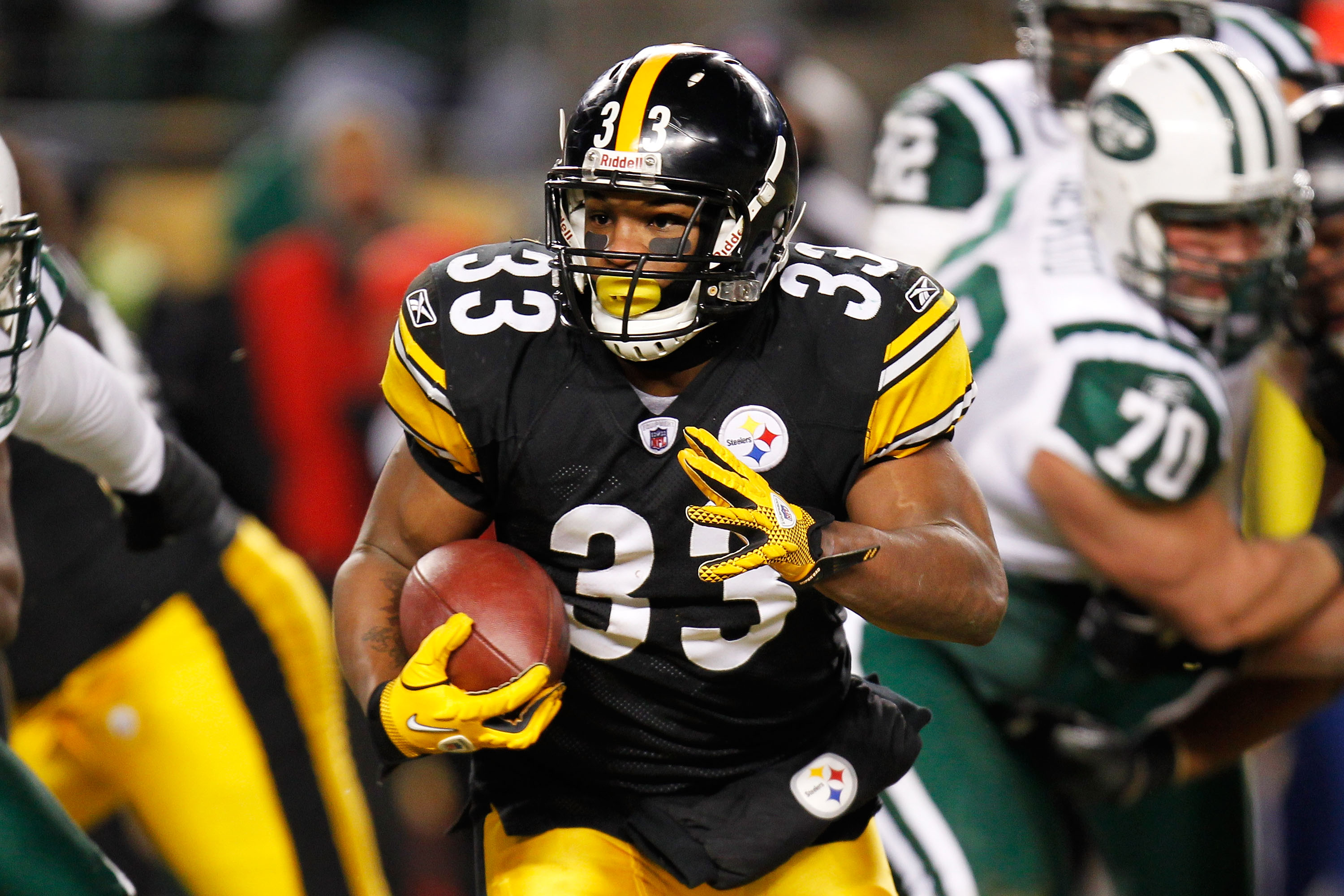 PITTSBURGH, PA - JANUARY 23:  Isaac Redman #33 of the Pittsburgh Steelers runs down field against the New York Jets during the 2011 AFC Championship game at Heinz Field on January 23, 2011 in Pittsburgh, Pennsylvania.  (Photo by Gregory Shamus/Getty Image