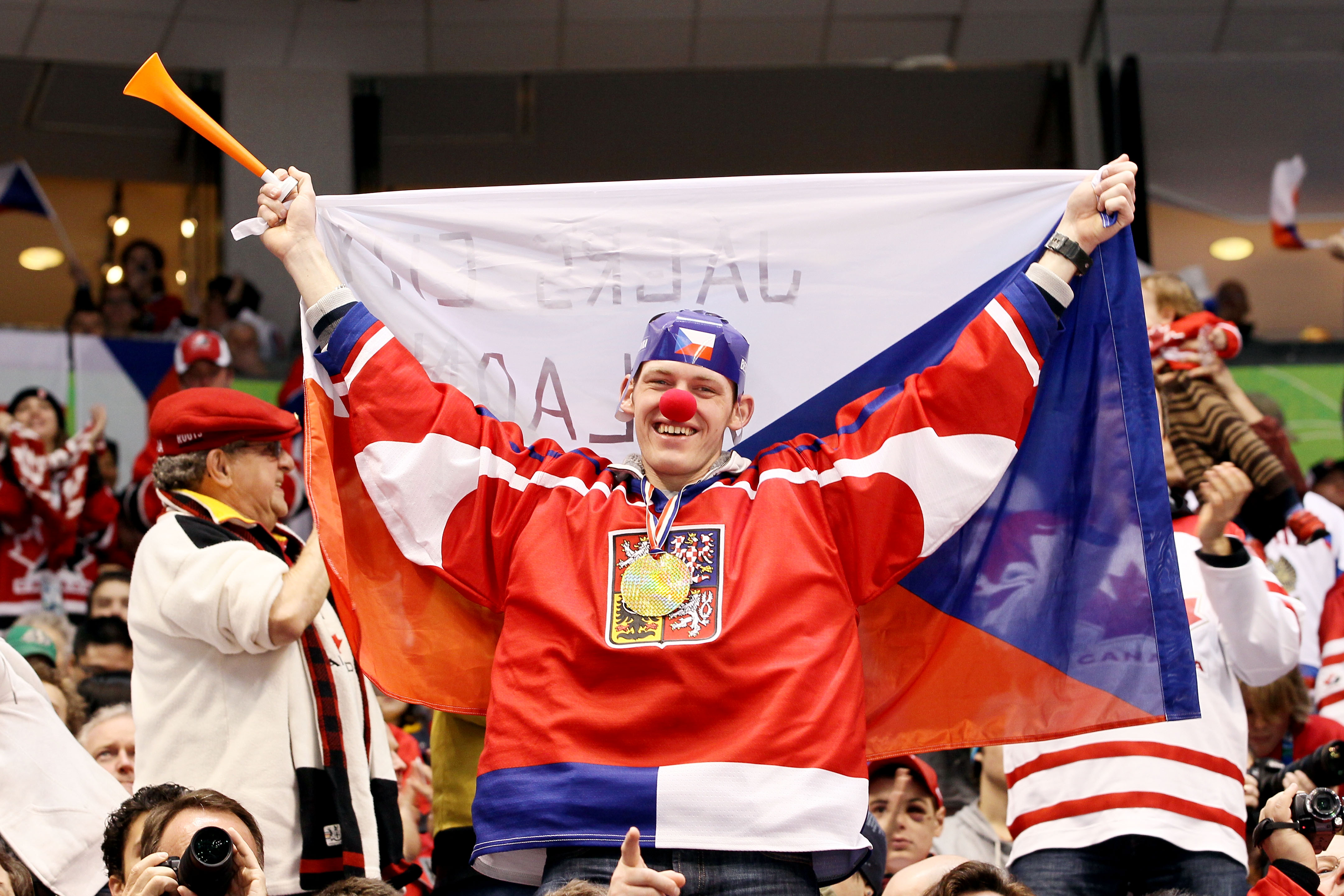 VANCOUVER, BC - FEBRUARY 21:  A fan of the Czech Republic holds up the countries flag as he supports the team during the ice hockey men's against the Russia Federation team on day 10 of the Vancouver 2010 Winter Olympics at Canada Hockey Place on February