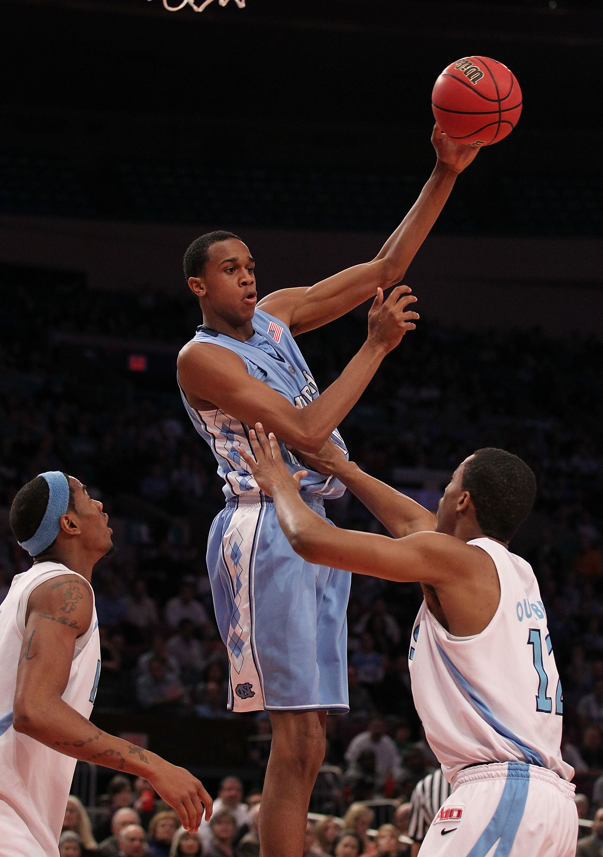 NEW YORK - MARCH 30:  John Henson #31 of the North Carolina Tar Heels passes the ball against Rhode Island Rams at Madison Square Garden on March 30, 2010 in New York, New York.  (Photo by Nick Laham/Getty Images)