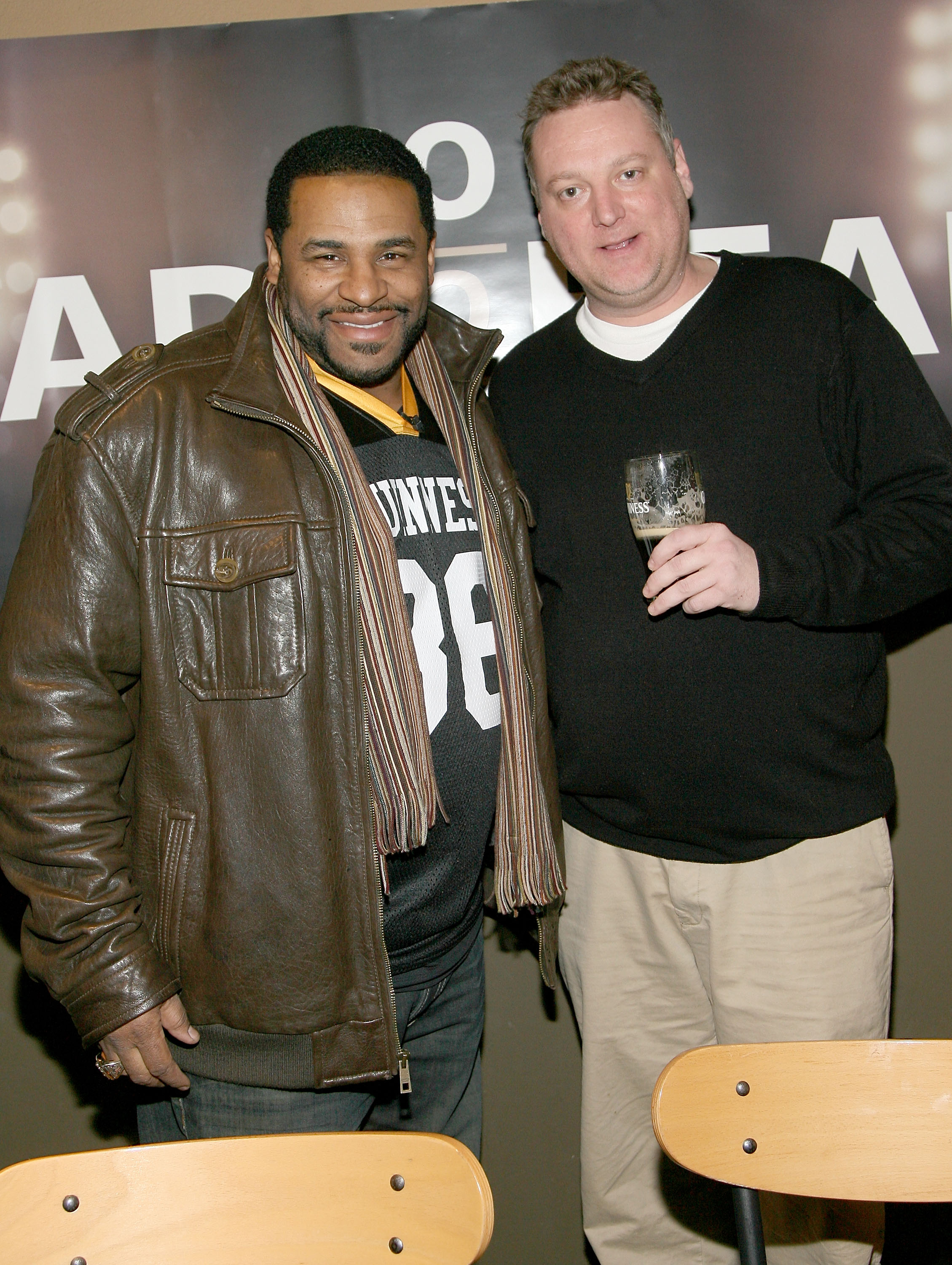 ARLINGTON, TX - FEBRUARY 03:  Former NFL player Jerome Bettis (Left) competes in the Guinness Perfect Pint Pour-Off at Buffalo Wild Wings on February 3, 2011 in Arlington, Texas.  (Photo by Maury Phillips/Getty Images for Guinness)