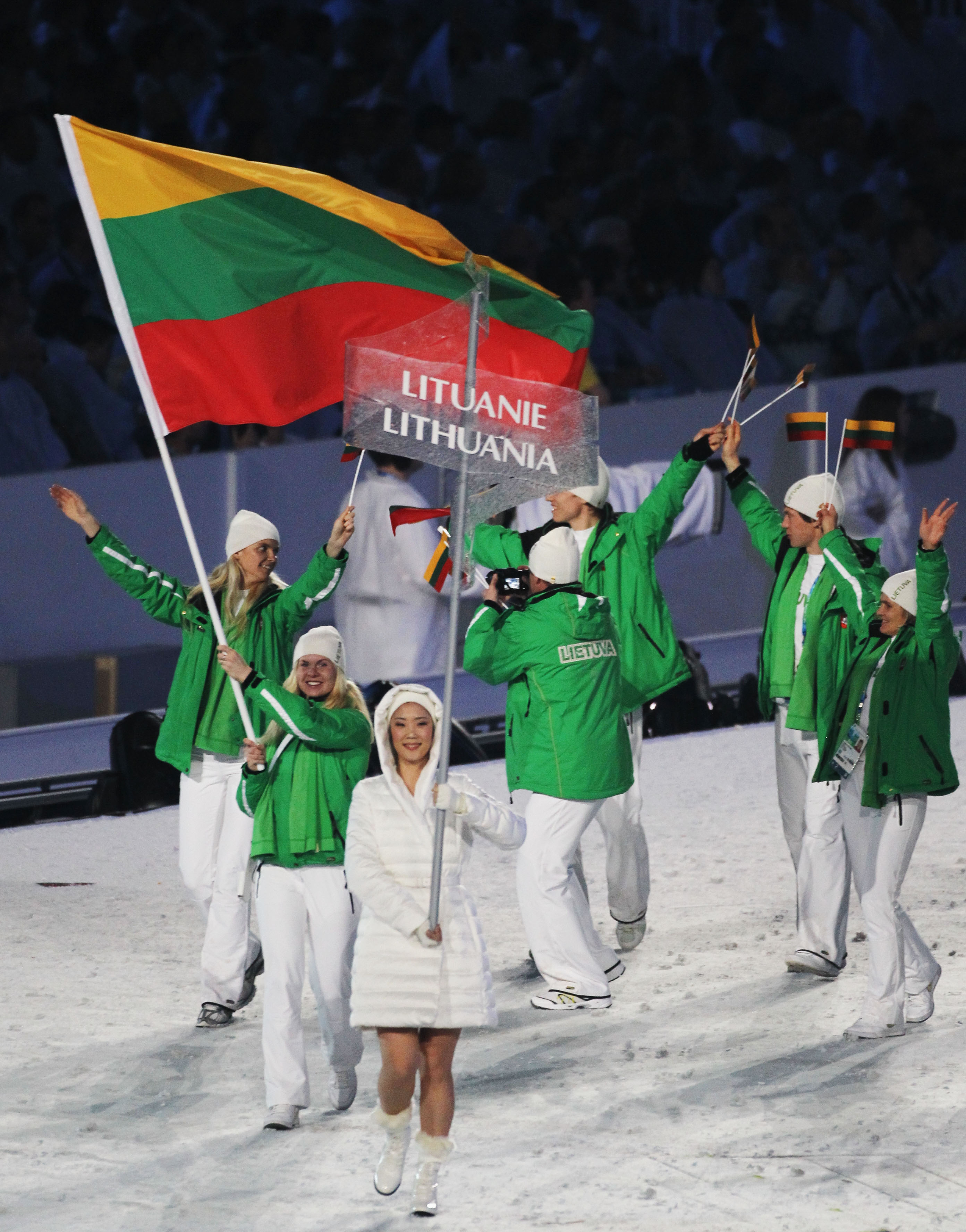 VANCOUVER, BC - FEBRUARY 12: Irina Terentjeva of Lithuania carries the flag during the Opening Ceremony of the 2010 Vancouver Winter Olympics at BC Place on February 12, 2010 in Vancouver, Canada.  (Photo by Matthew Stockman/Getty Images)