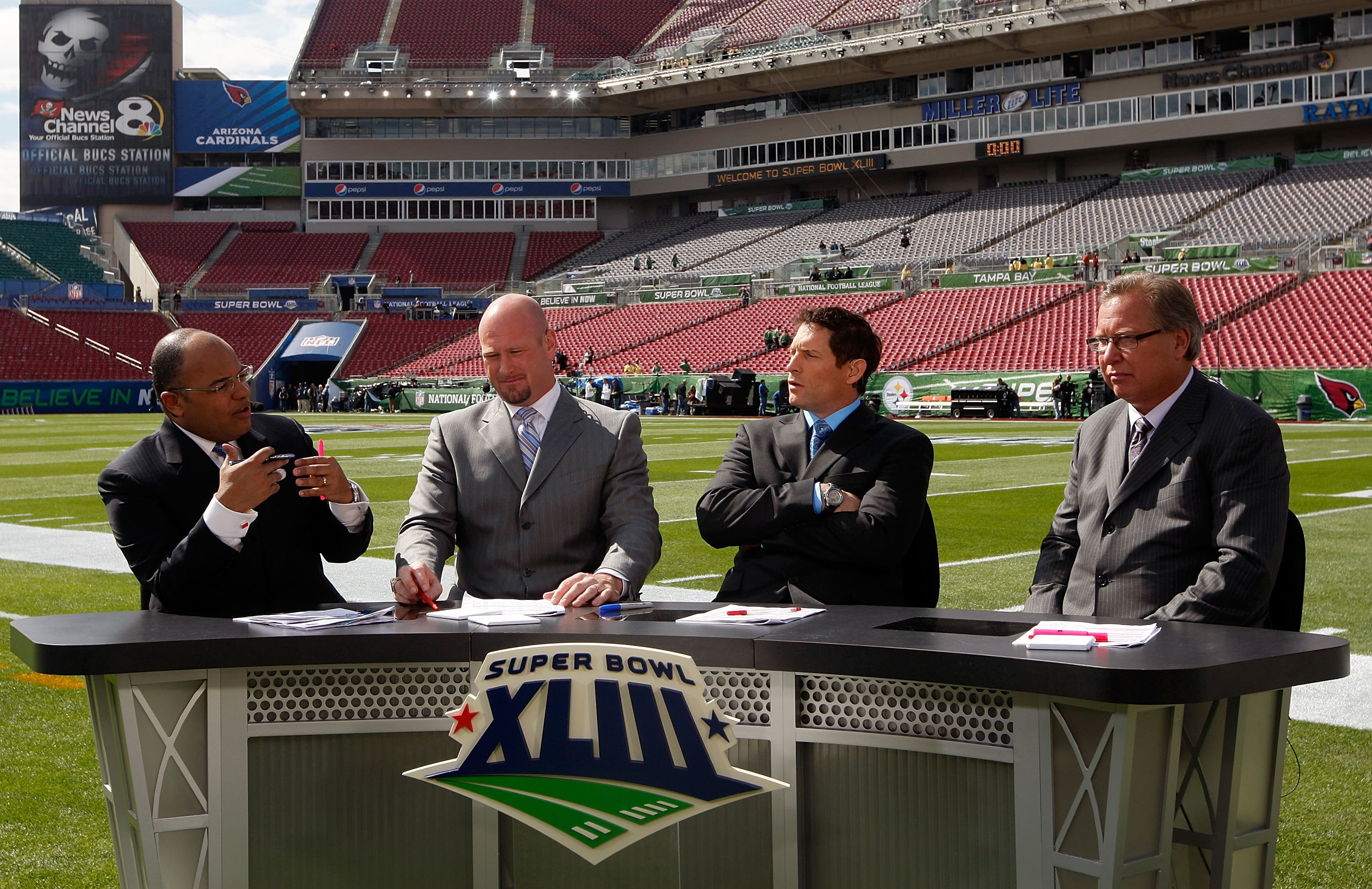 TAMPA, FL - FEBRUARY 01:  (L-R) The ESPN pregame show with host Mike Tirico and analysts Trent Dilfer, Steve Young and Ron Jaworski before Super Bowl XLIII on February 1, 2009 at Raymond James Stadium in Tampa, Florida.  (Photo by Jamie Squire/Getty Image