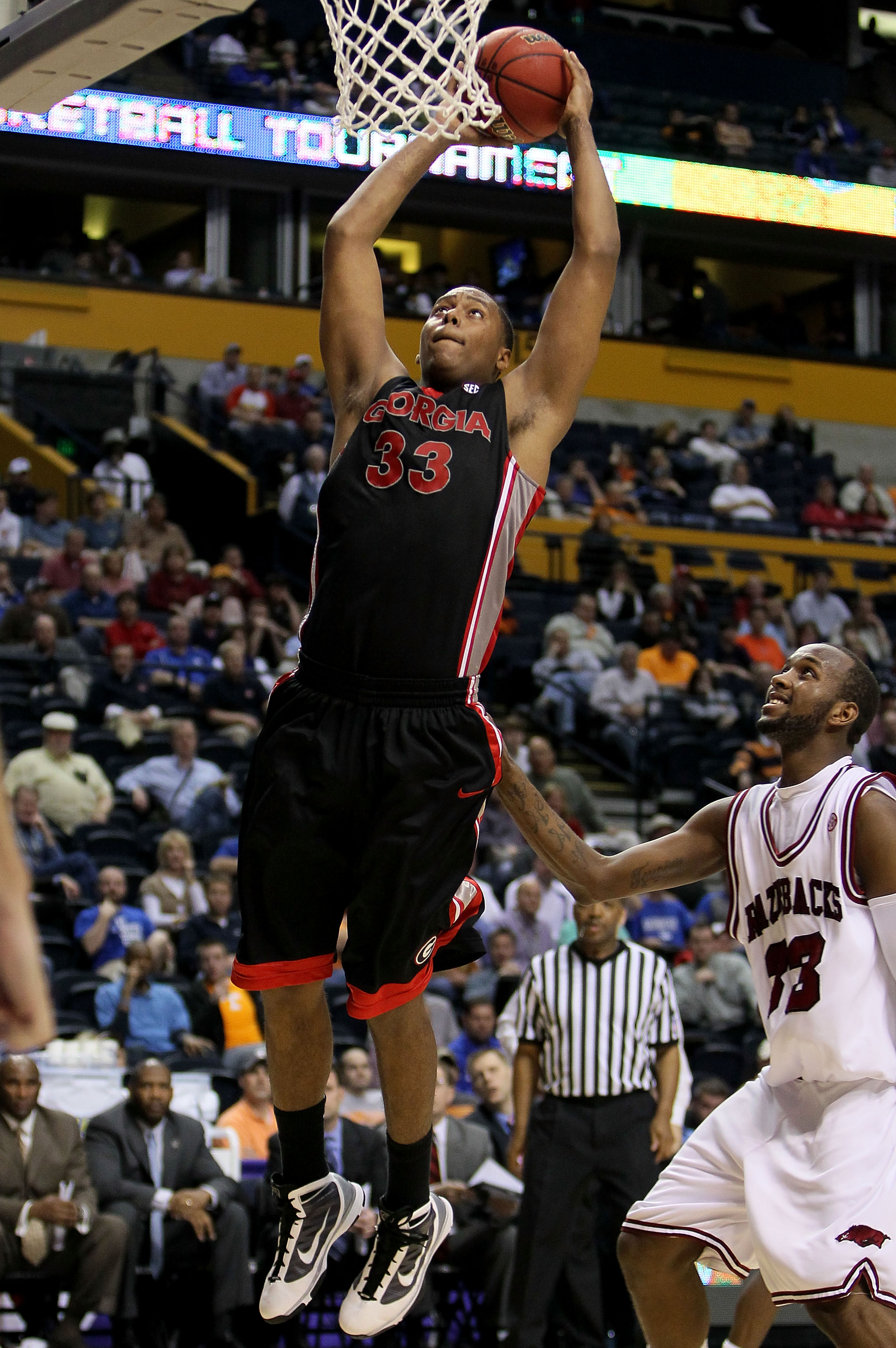 NASHVILLE, TN - MARCH 11:  Trey Thompkins #33 of the Georgia Bulldogs goes up for a dunk attempt against the Arkanasas Razorbacks during the first round of the SEC Men's Basketball Tournament at the Bridgestone Arena on March 11, 2010 in Nashville, Tennes