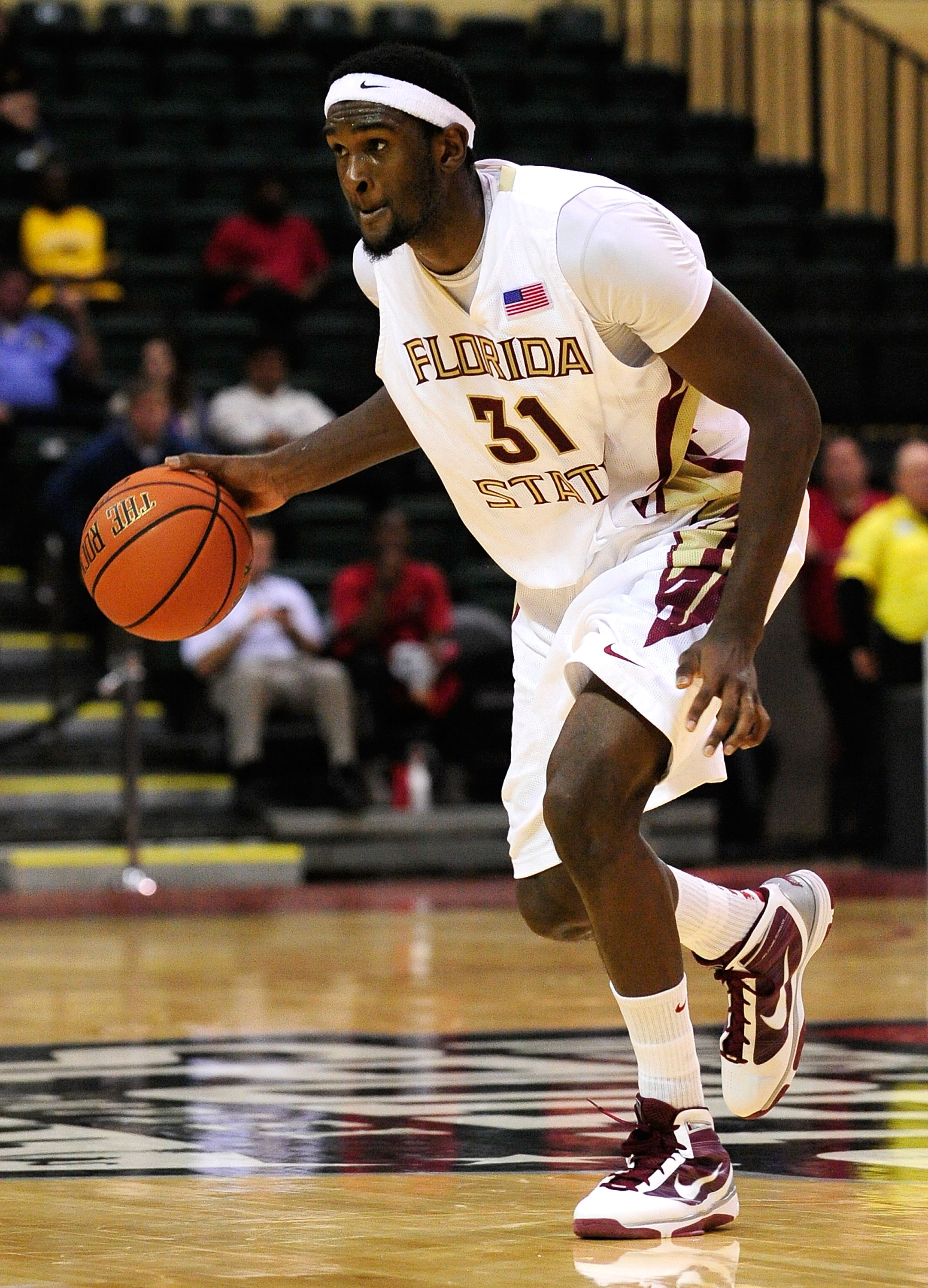 ORLANDO, FL - NOVEMBER 27:  Chris Singleton #31 of the Florida State Seminoles looks to pass against the Alabama Crimson Tide during the Old Spice Classic at Disney's Milk House on November 27, 2009 in Orlando, Florida.  (Photo by Sam Greenwood/Getty Imag