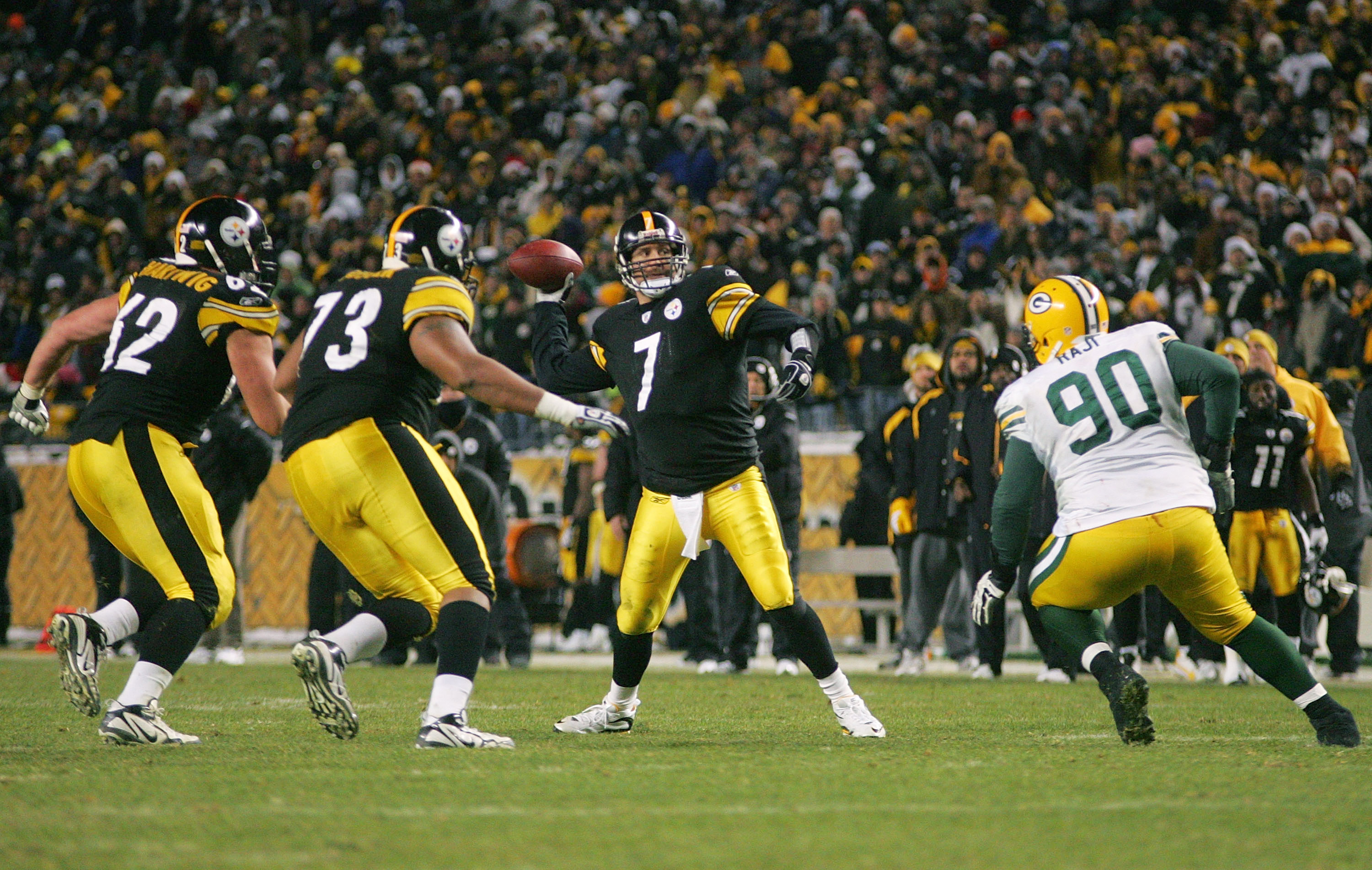 PITTSBURGH - DECEMBER 20: Ben Roethlisberger #7 of the Pittsburgh Steelers throws the game winning touchdown pass in the fourth quarter in front of BJ Raji #90 of the Green Bay Packers during the game on December 20, 2009 at Heinz Field in Pittsburgh, Pen