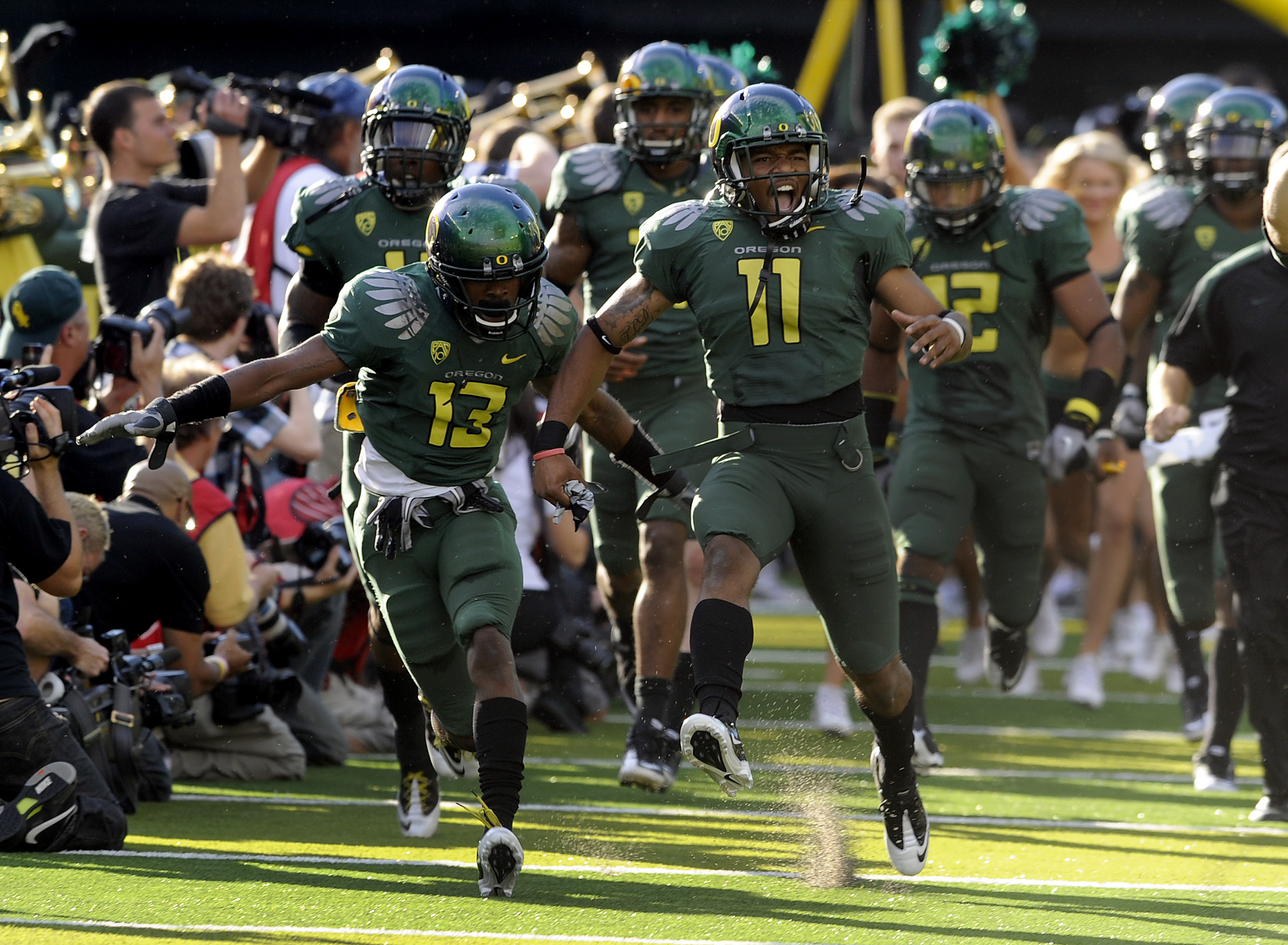 EUGENE, OR - OCTOBER 2: Cornerback Cliff Harris #13  and rover Eddie Pleasant #11 of the Oregon Ducks lead the team onto the field for the game against the Stanford Cardinal at Autzen Stadium on October 2, 2010 in Eugene, Oregon. Oregon won the game 52-31