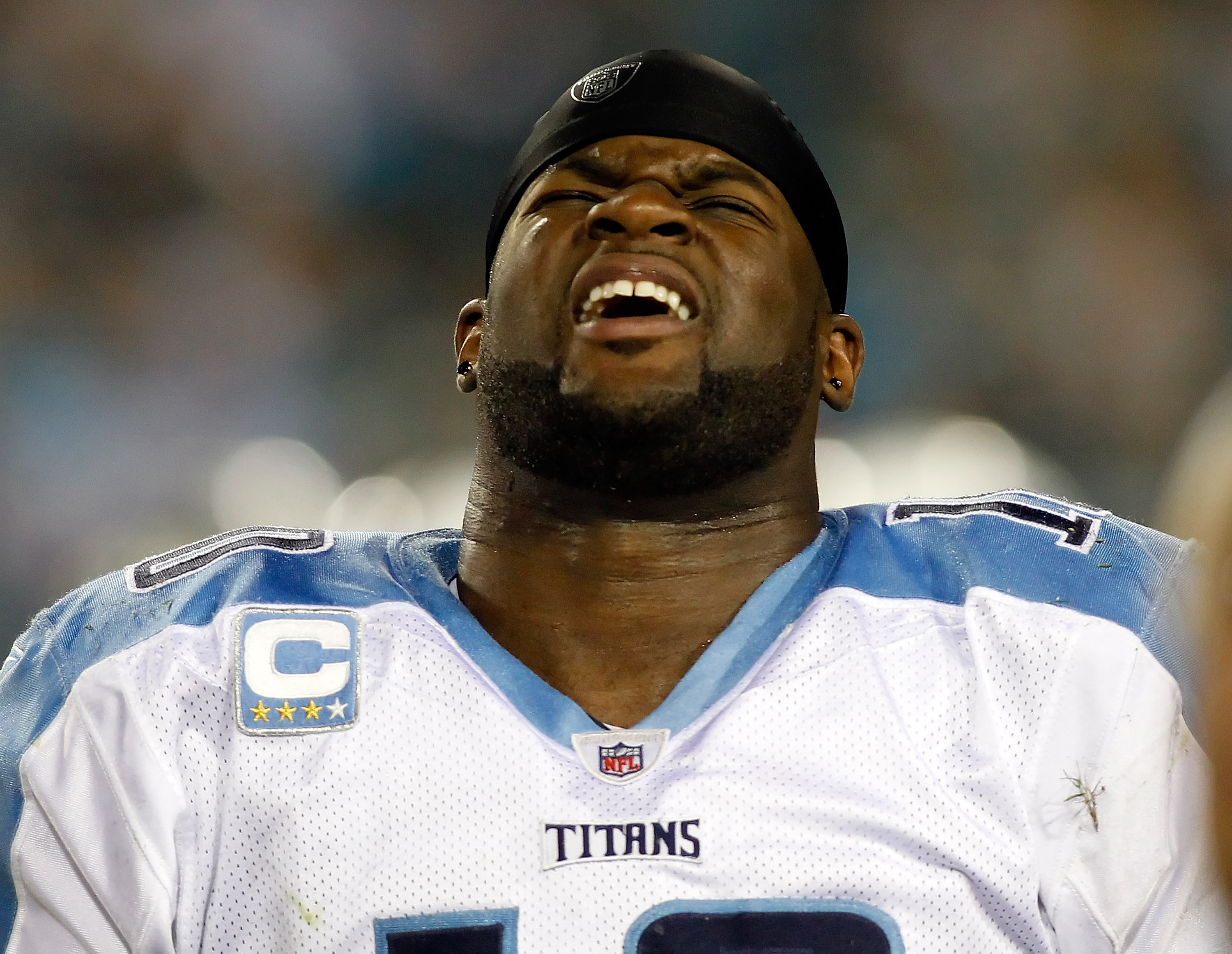 JACKSONVILLE, FL - OCTOBER 18:  Quarterback Vince Young #10 of the Tennessee Titans grimaces in pain during the first quarter against the Jacksonville Jaguars during the game at EverBank Field on October 18, 2010 in Jacksonville, Florida.  (Photo by J. Me