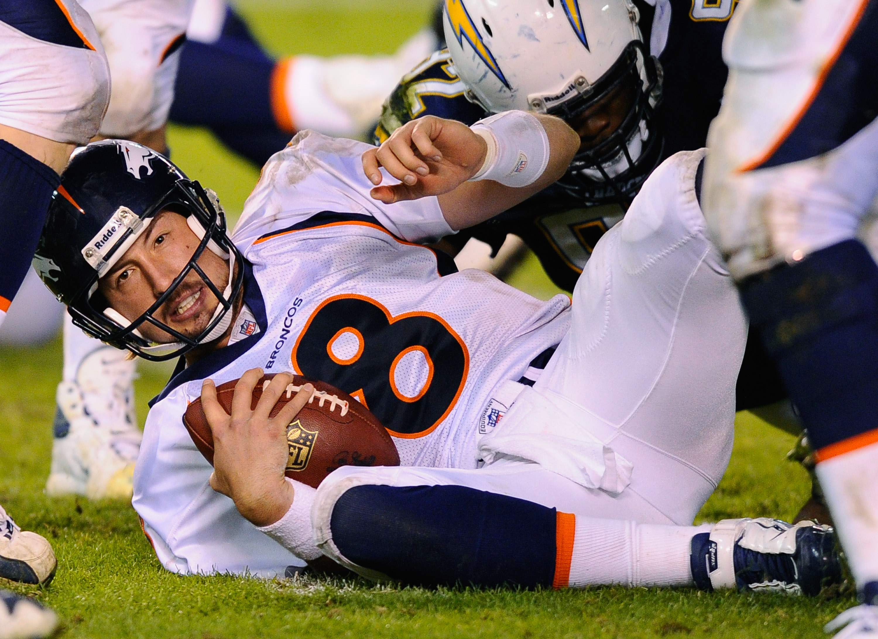 SAN DIEGO - NOVEMBER 22:  Quarterback Kyle Orton #8 of the Denver Broncos is sacked by Larry English #52 of the San Diego Chargers at Qualcomm Stadium on November 22, 2010 in San Diego, California. Chargers defeated the Broncos 35-14.  (Photo by Kevork Dj
