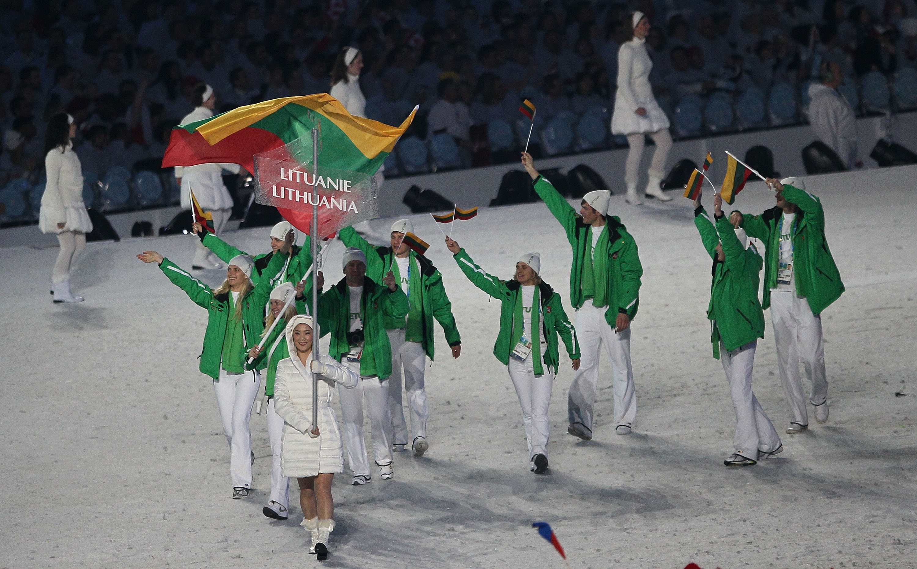 VANCOUVER, BC - FEBRUARY 12:  Irina Terentjeva of Lithuania carries the flag during the Opening Ceremony of the 2010 Vancouver Winter Olympics at BC Place on February 12, 2010 in Vancouver, Canada.  (Photo by Bruce Bennett/Getty Images)
