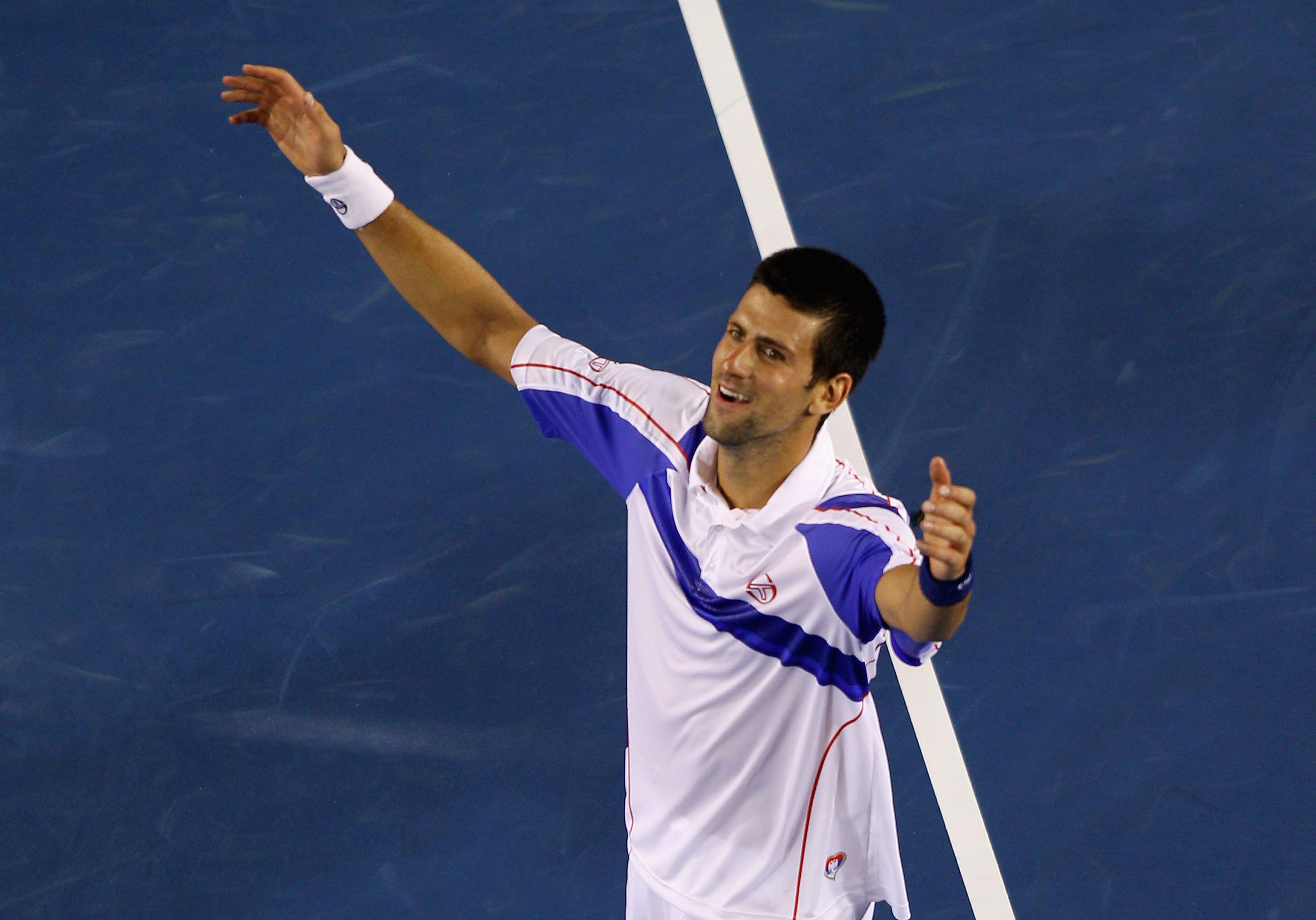 MELBOURNE, AUSTRALIA - JANUARY 30:  Novak Djokovic of Serbia celebrates in his men's final match against Andy Murray of Great Britain during day fourteen of the 2011 Australian Open at Melbourne Park on January 30, 2011 in Melbourne, Australia.  (Photo by