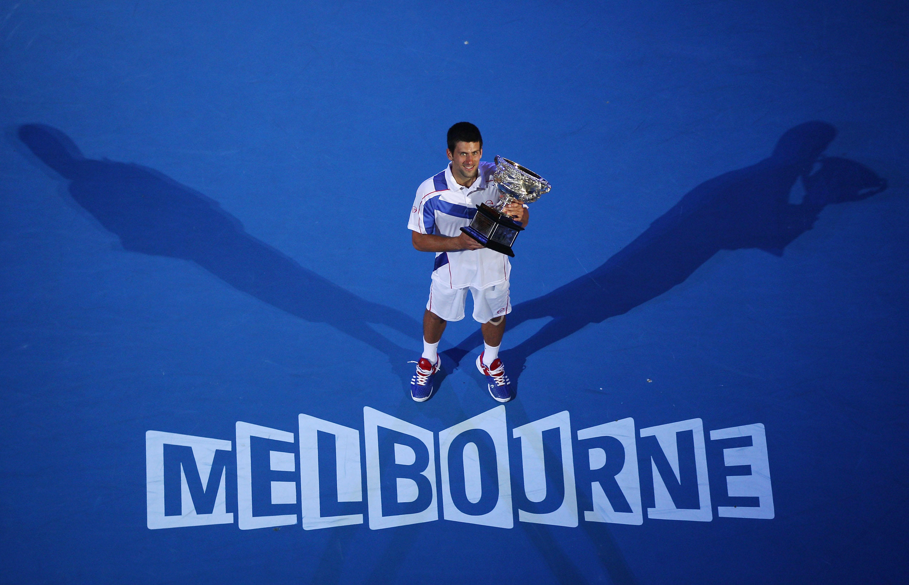 MELBOURNE, AUSTRALIA - JANUARY 30:  Novak Djokovic of Serbia holds the Norman Brookes Challenge Cup after winning his men's final match against Andy Murray of Great Britain during day fourteen of the 2011 Australian Open at Melbourne Park on January 30, 2