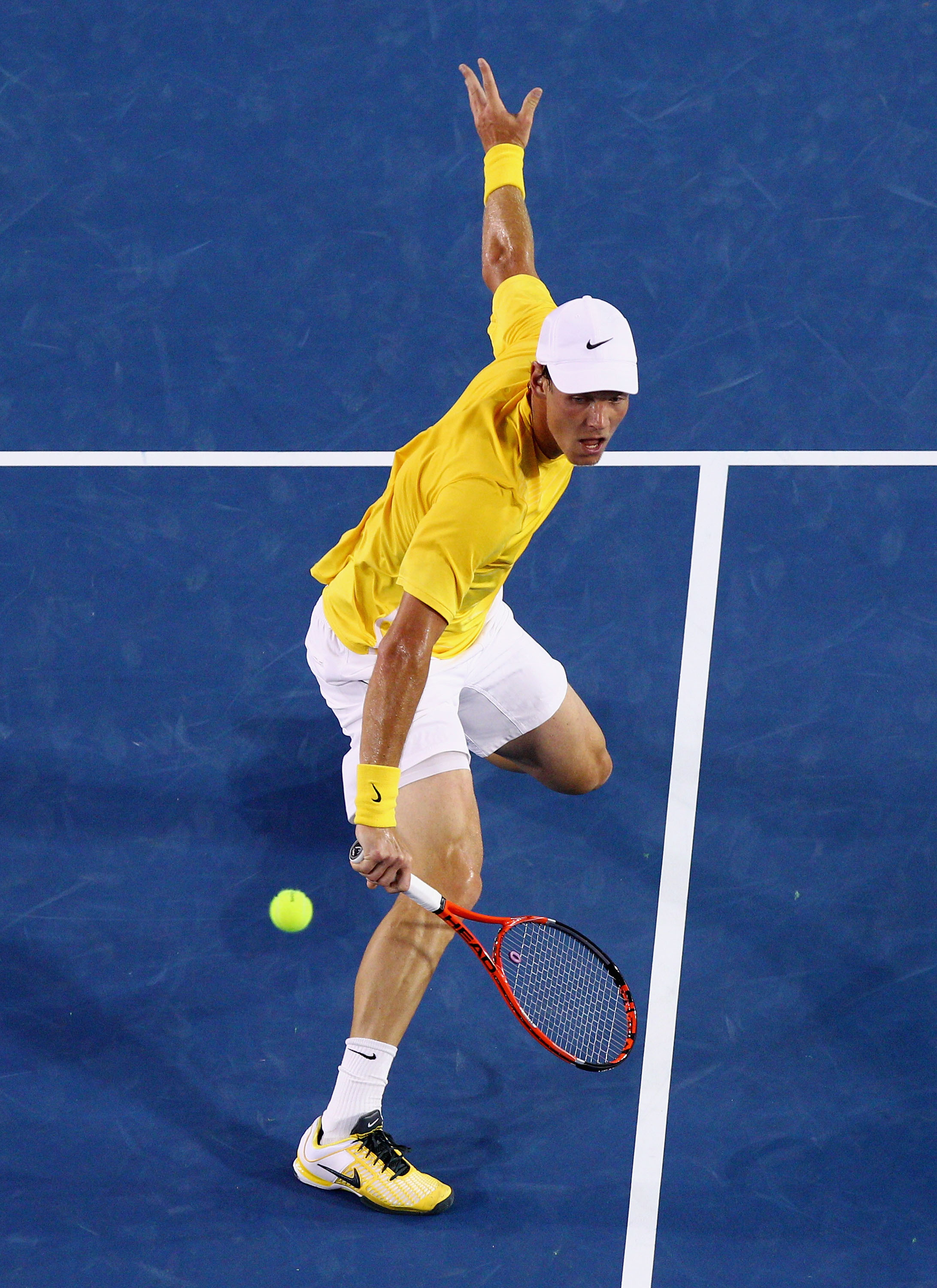 MELBOURNE, AUSTRALIA - JANUARY 25:  Tomas Berdych of the Czech Republic plays a backhand in his quarterfinal match against Novak Djokovic of Serbia during day nine of the 2011 Australian Open at Melbourne Park on January 25, 2011 in Melbourne, Australia.