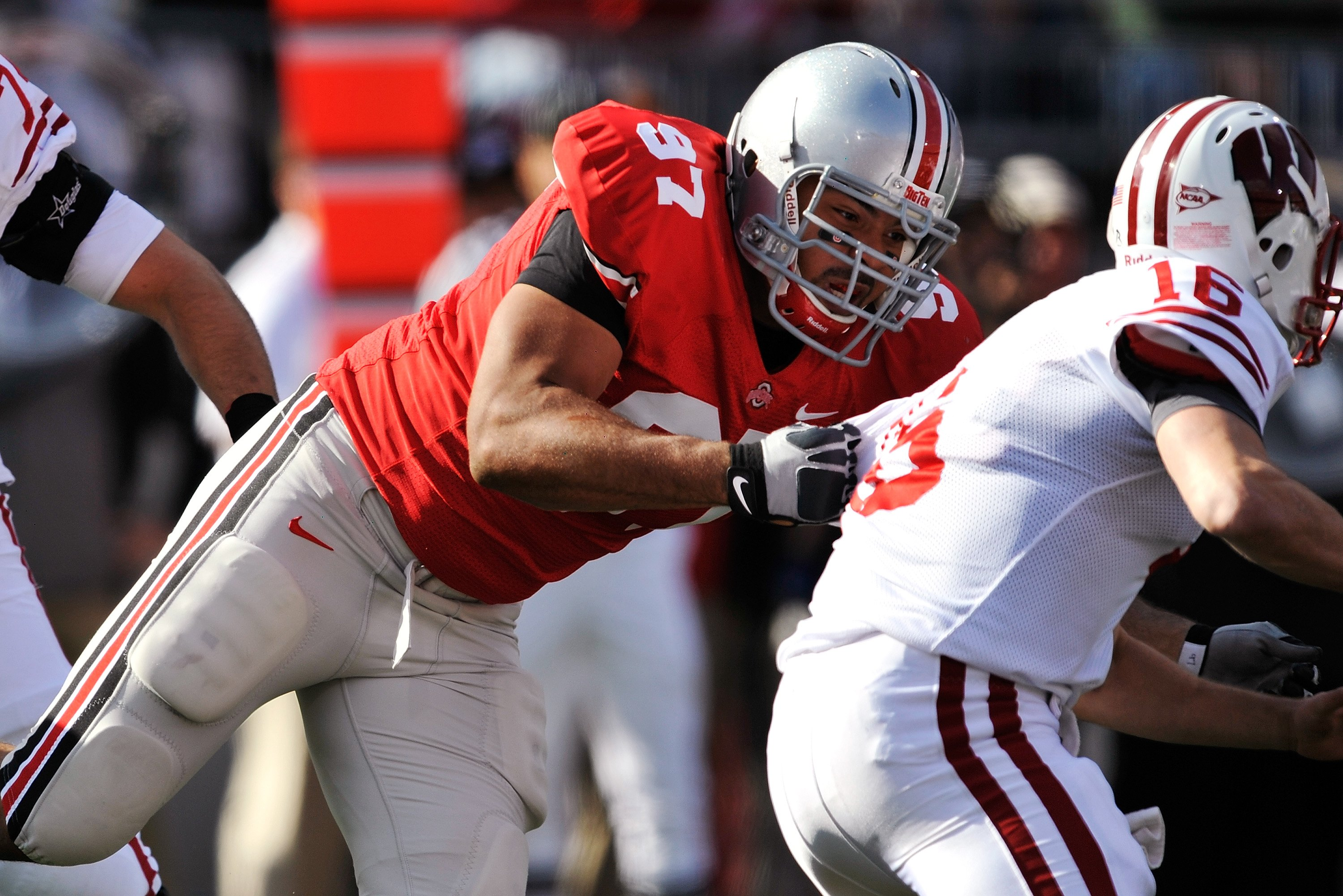 COLUMBUS, OH - OCTOBER 10:  Defensive lineman Cameron Heyward #97of the Ohio State Buckeyes makes a tackle on quarterback Scott Tolzien #16 of the Wisconsin Badgers at Ohio Stadium on October 10, 2009 in Columbus, Ohio.  (Photo by Jamie Sabau/Getty Images