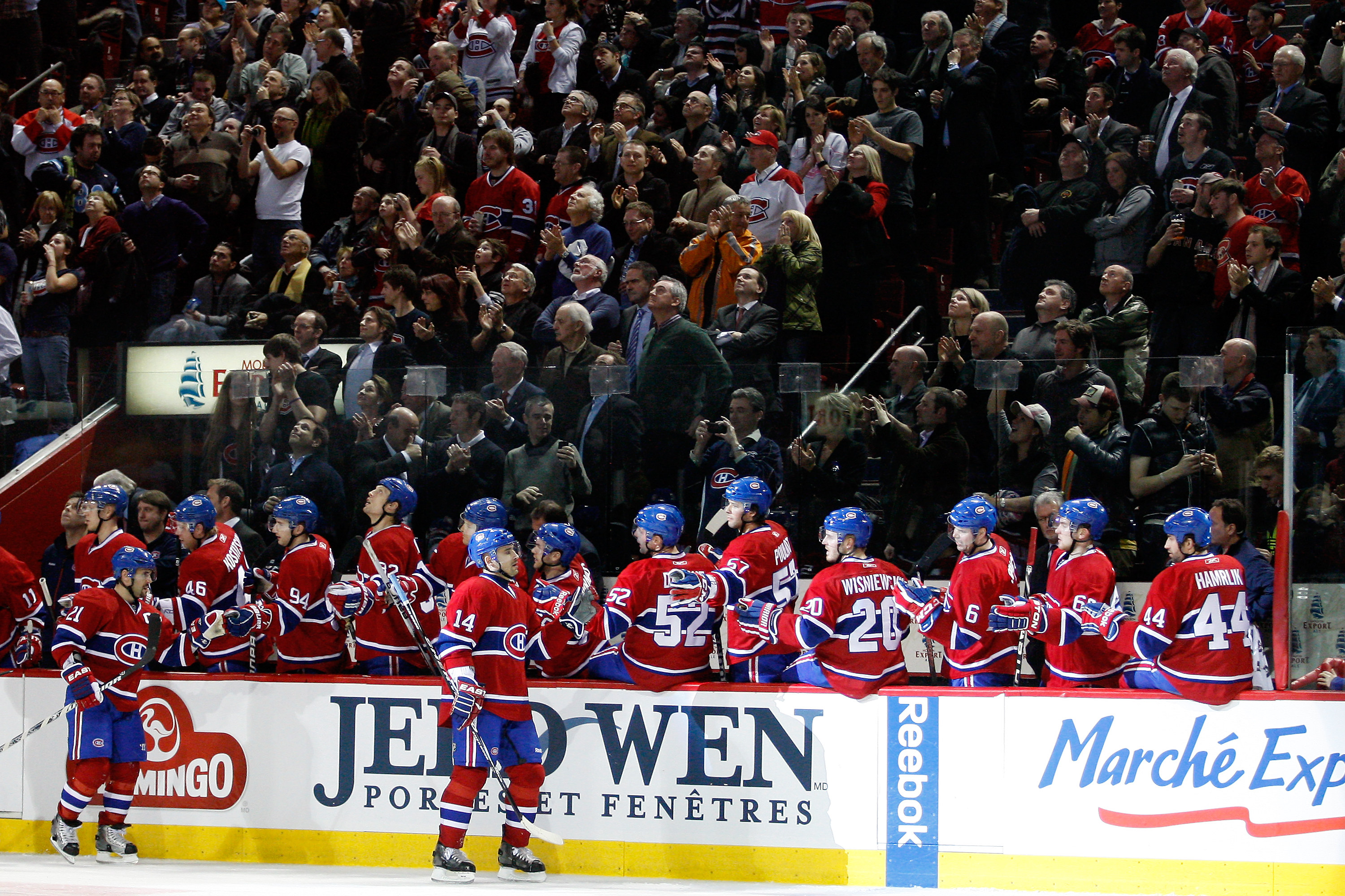 MONTREAL, CANADA - FEBRUARY 2:  Tomas Plekanec #14 of the Montreal Canadiens celebrates his third-period goal with teammates during the NHL game against the Florida Panthers at the Bell Centre on February 2, 2011 in Montreal, Quebec, Canada.  The Canadien