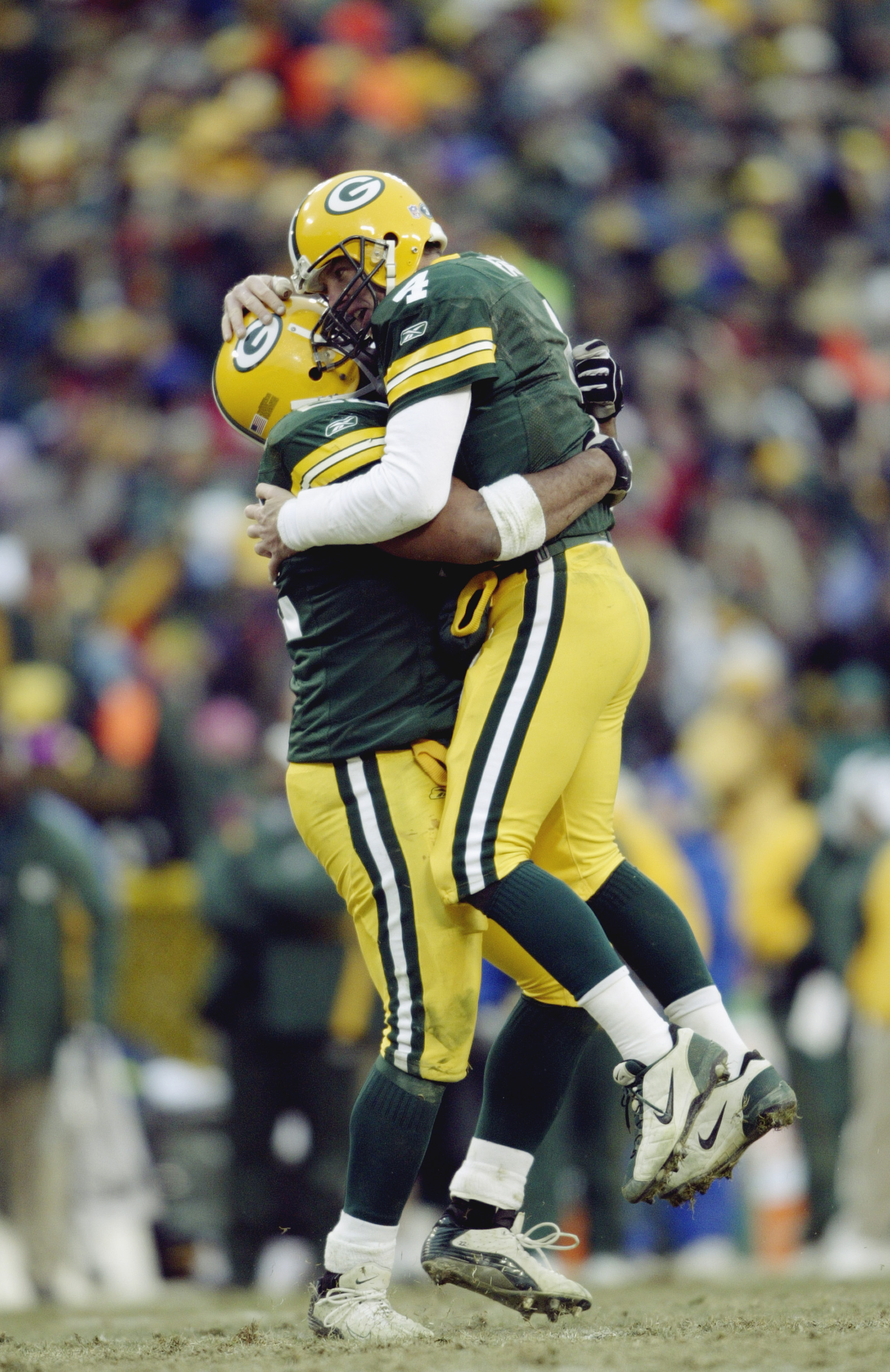 GREEN BAY, WI - JANUARY 4: Quarterback Brett Favre #4 and fullback Nick Luchey #22 of the Green Bay Packers hug during the NFC playoff game against the Seattle Seahawks on January 4, 2004 in Lambeau Field in Green Bay, Wisconsin. The Packers defeated the