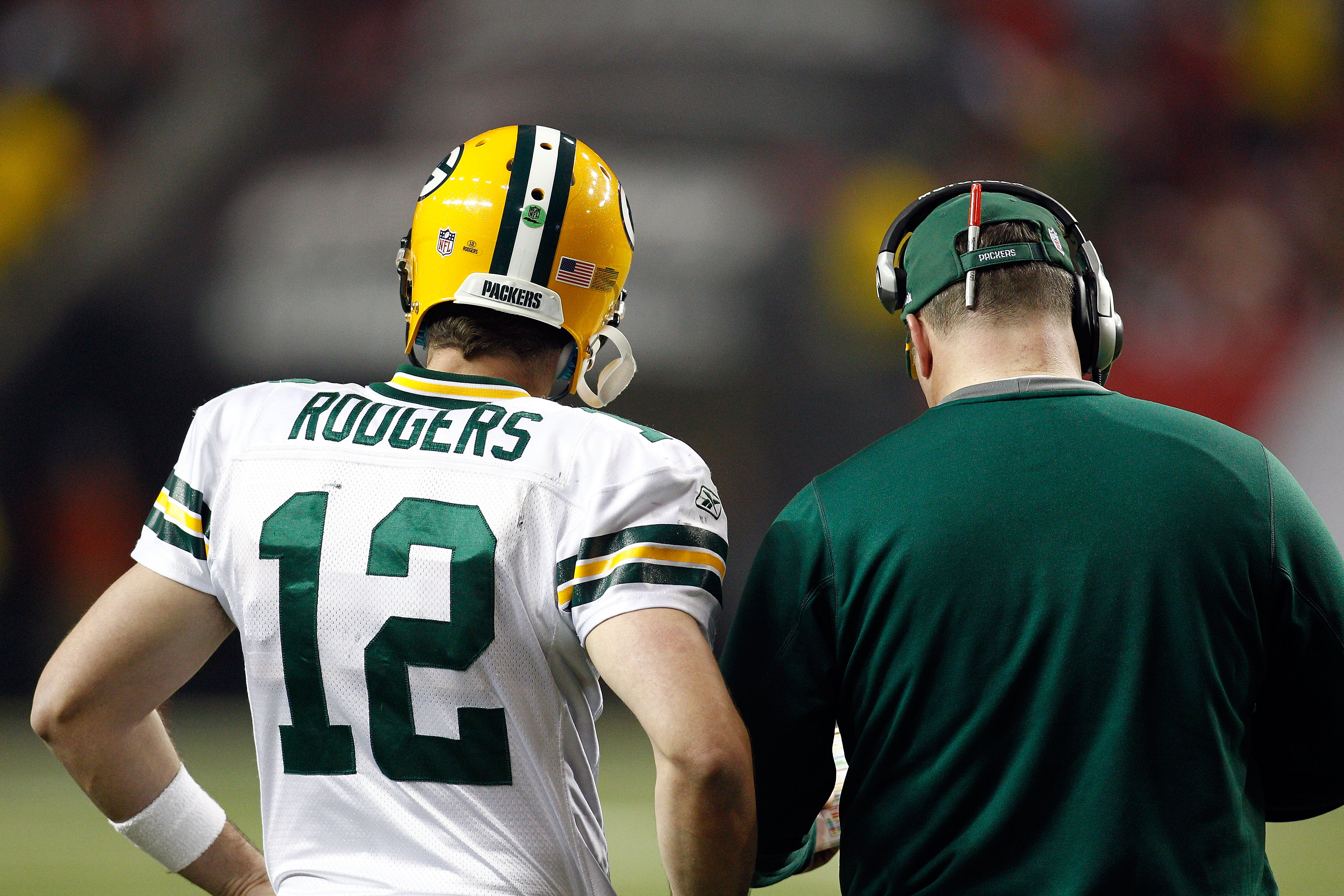 ATLANTA, GA - JANUARY 15:  (L-R) Quarterback Aaron Rodgers #12 and head coach Mike McCarthy of the Green Bay Packers talk on the sideline against the Atlanta Falcons during their 2011 NFC divisional playoff game at Georgia Dome on January 15, 2011 in Atla