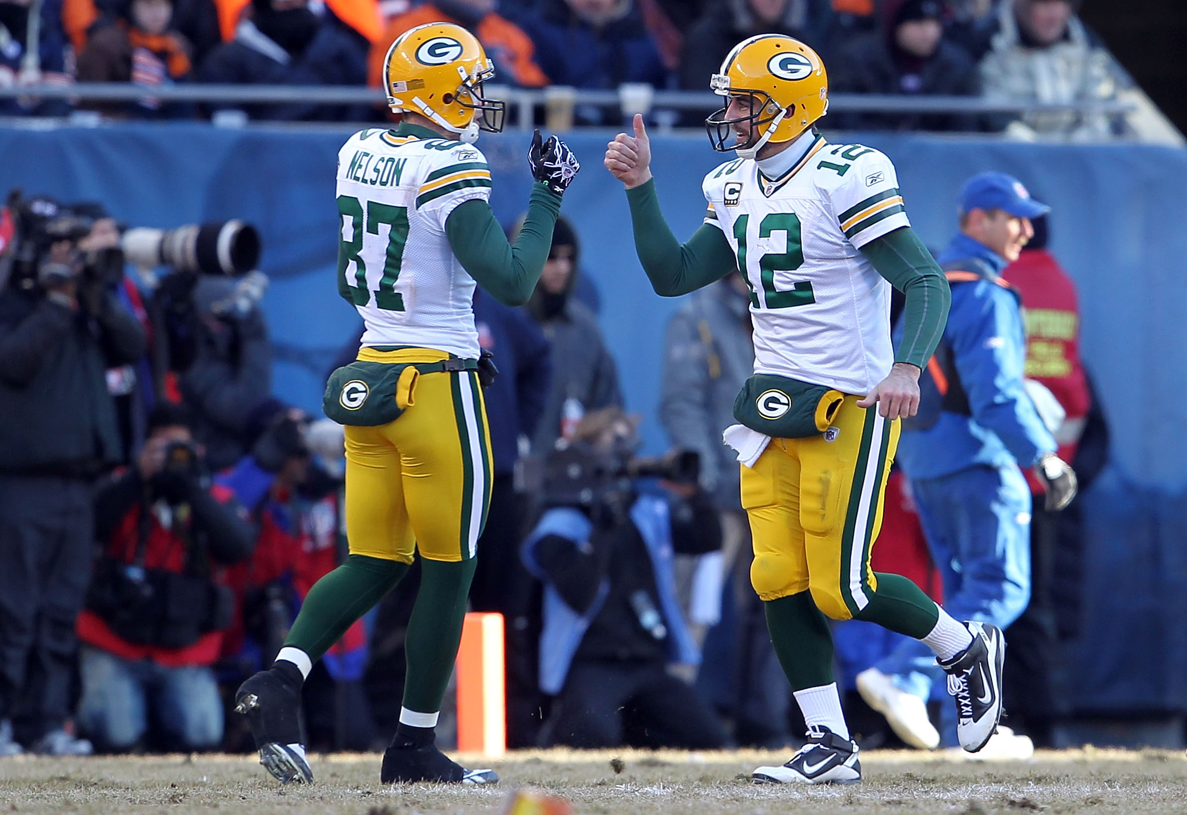 CHICAGO, IL - JANUARY 23:  Wide receiver Jordy Nelson #87 and Aaron Rodgers #12 of the Green Bay Packers react after running back James Starks #44 of the Packers scores on a four-yard touchdown in the second quarter against the Chicago Bears in the NFC Ch