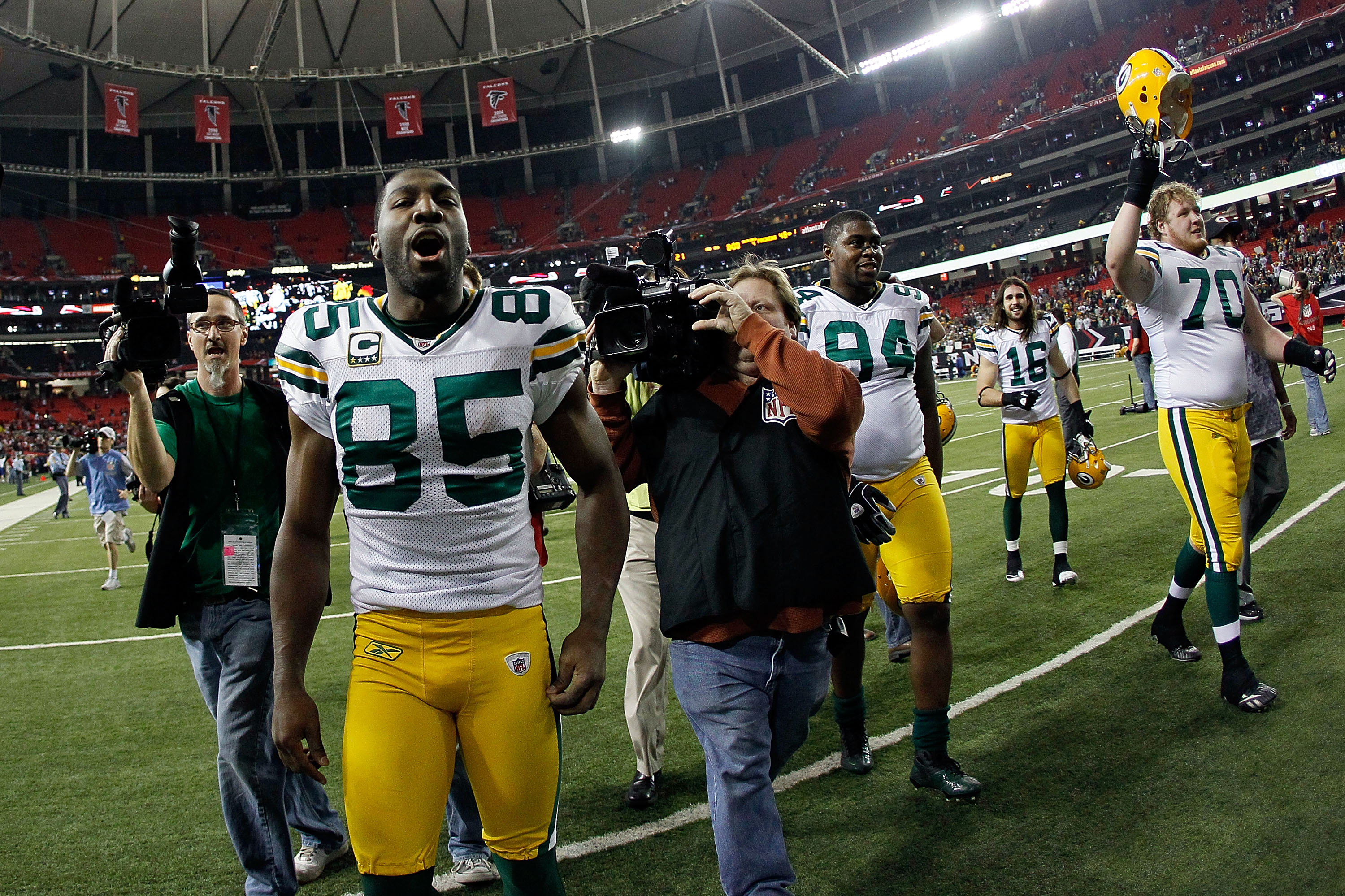 ATLANTA, GA - JANUARY 15:  (L-R) Greg Jennings #85, Jarius Wynn #94, Brett Swain #16 and T.J. Lang #70 of the Green Bay Packers celebrate as they walk off the field after the Packers won 48-21 against the Atlanta Falcons during their 2011 NFC divisional p