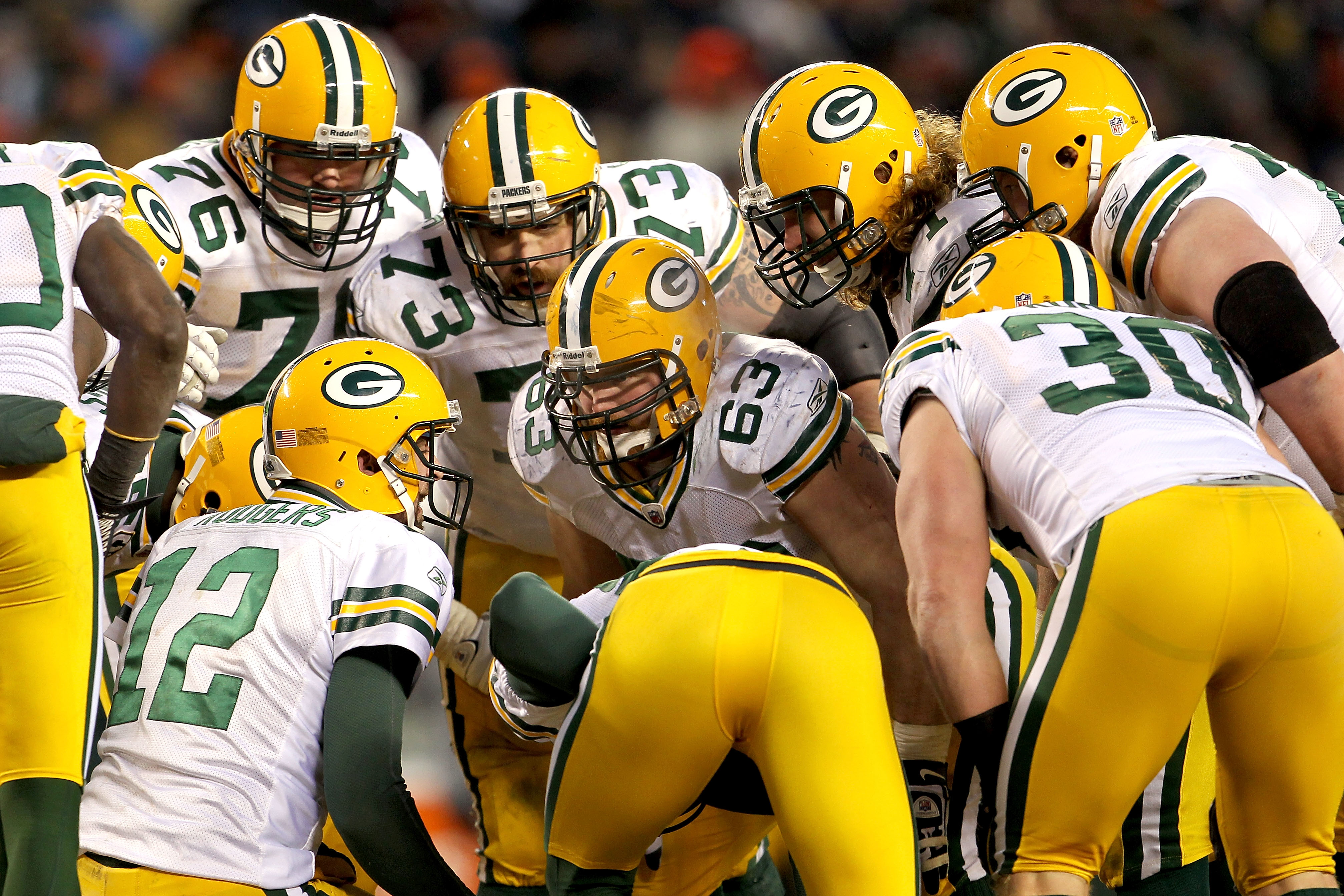 CHICAGO, IL - JANUARY 23:  Aaron Rodgers #12 of the Green Bay Packers huddles with his teammates against the Chicago Bears in the NFC Championship Game at Soldier Field on January 23, 2011 in Chicago, Illinois.  (Photo by Jamie Squire/Getty Images)