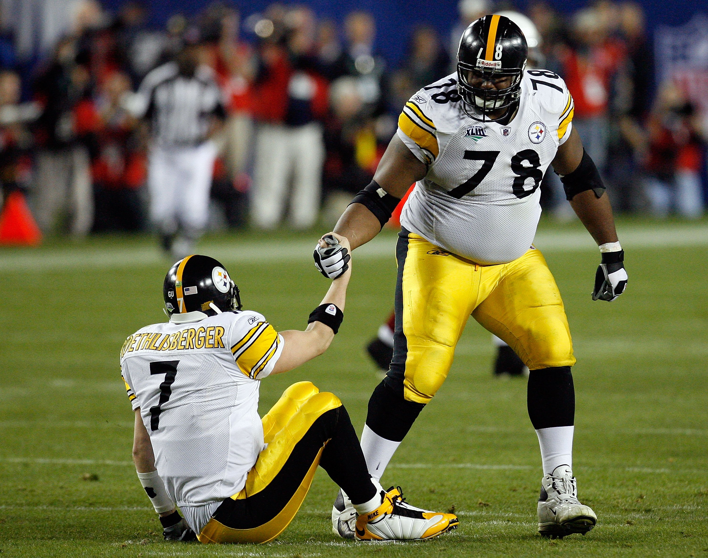 TAMPA, FL - FEBRUARY 01:  Quarterback Ben Roethlisberger #7 of the Pittsburgh Steelers is helped up by teammate Max Starks #78 against the Arizona Cardinals during Super Bowl XLIII on February 1, 2009 at Raymond James Stadium in Tampa, Florida.  (Photo by