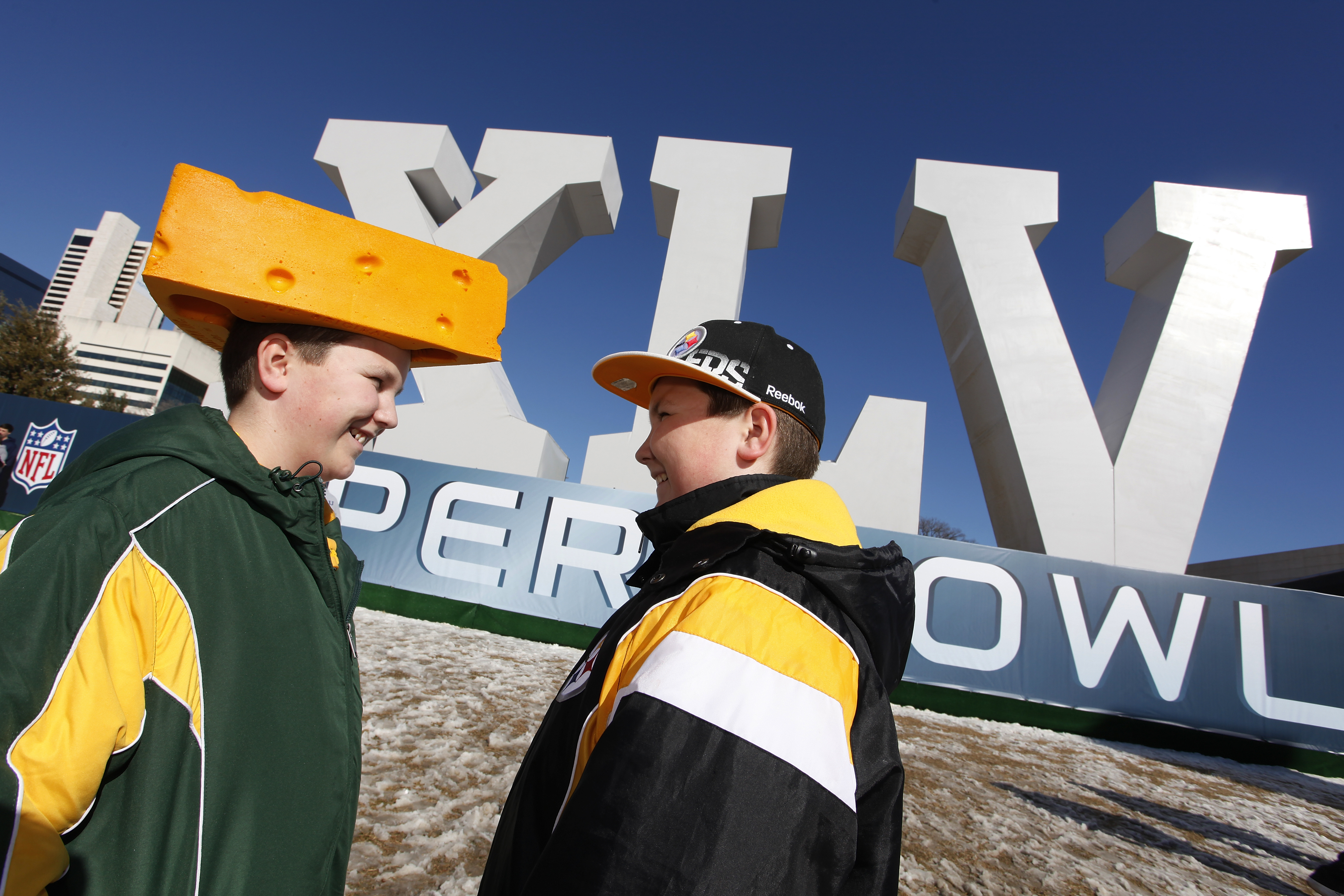 DALLAS, TX - FEBRUARY 5:  Twin brothers Michael (left) and Jon Mangless of Green Bay, Wisconsin wait outside before visiting the NFL Experience at the Dallas Convention Center on February 5, 2011 in Dallas, Texas. (Photo by Joe Robbins/Getty Images)