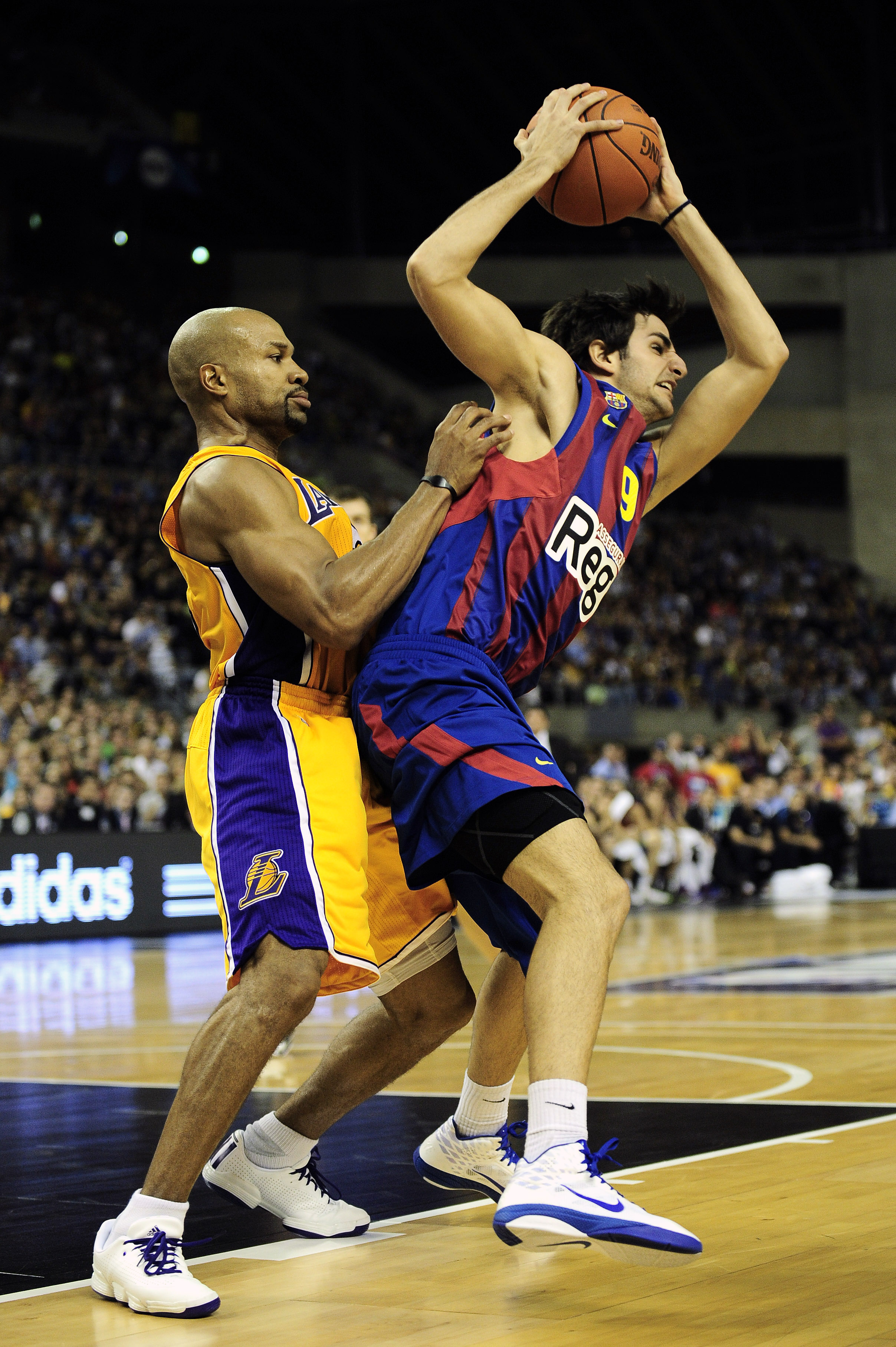 BARCELONA, SPAIN - OCTOBER 07:  Ricky Rubio (R) #9 of the FC Barcelona duels  for a ball against Derek Fisher #2 of the Los Angeles Lakers during the NBA Europe Live match between Los Angeles Lakers and Regal FC Barcelona at the at Palau Blaugrana on Octo
