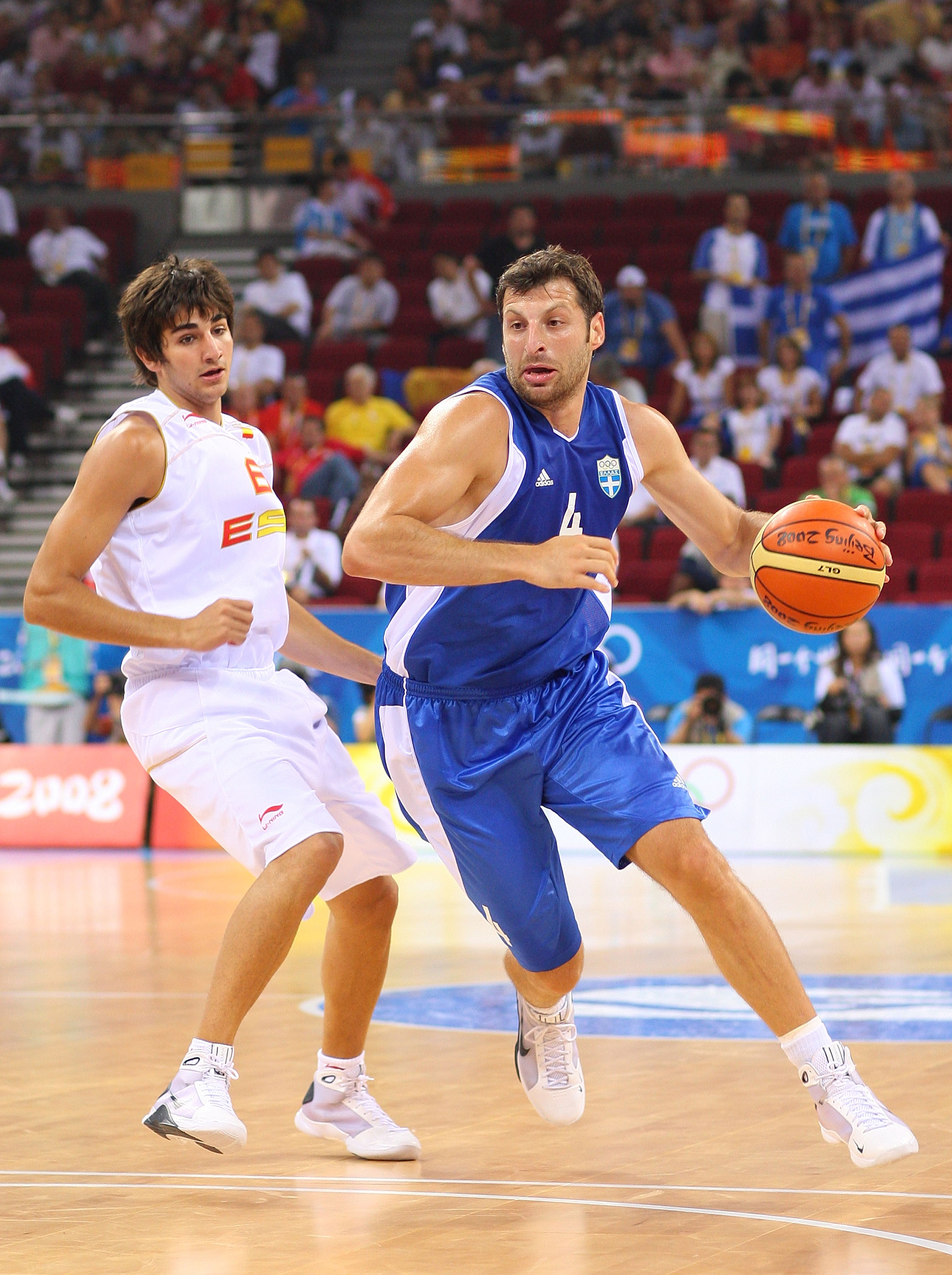 BEIJING - AUGUST 10:  Theodoros Papaloukas #4 of Greece drives on Ricky Rubio #6 of Spain during the day 2 preliminary game at the Beijing 2008 Olympic Games in the Beijing Olympic Basketball Gymnasium on August 10, 2008 in Beijing, China.  (Photo by Phil