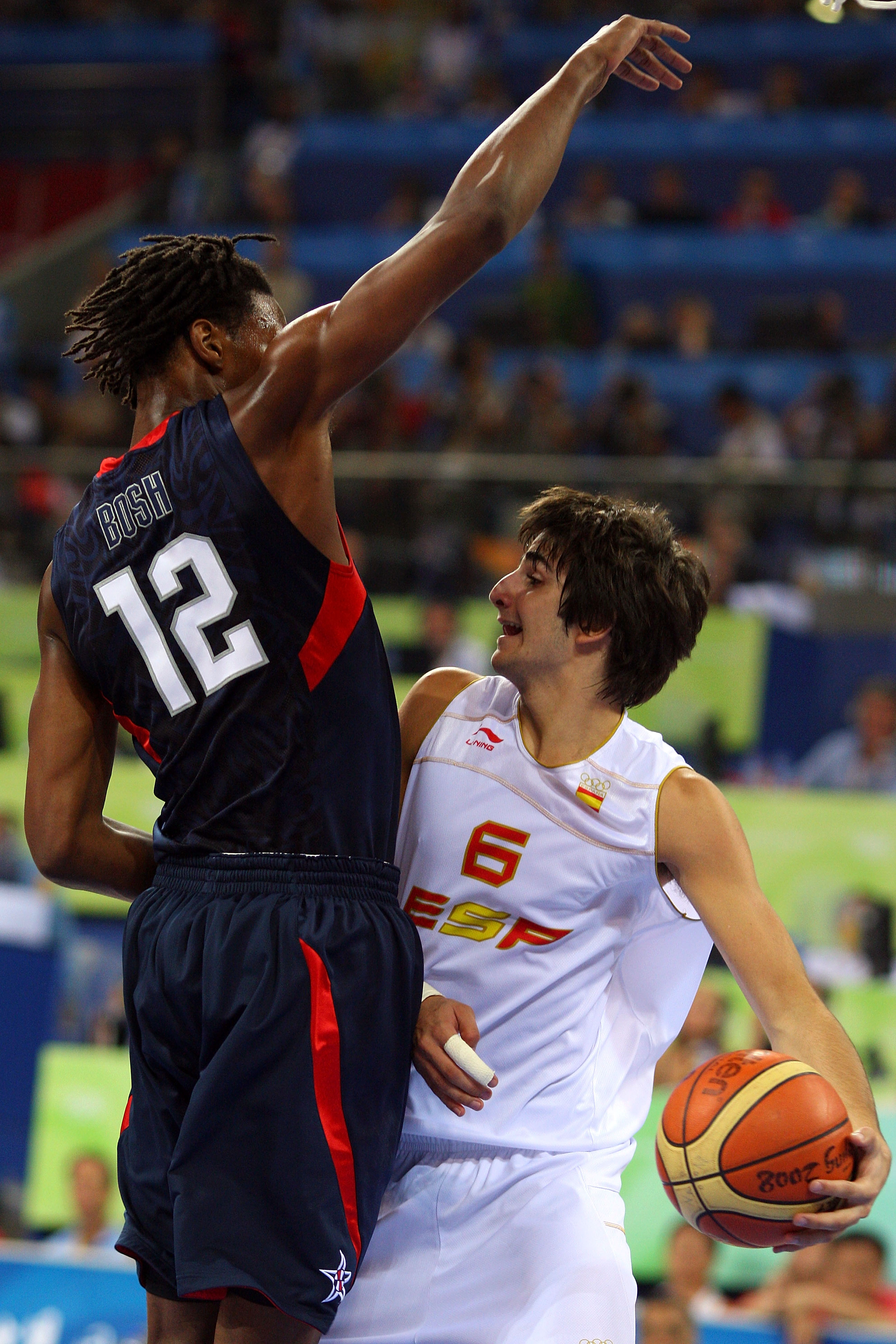 BEIJING - AUGUST 24:  Ricky Rubio #6 of Spain moves against the defense of Chris Bosh #12 of the United States in the gold medal game during Day 16 of the Beijing 2008 Olympic Games at the Beijing Olympic Basketball Gymnasium on August 24, 2008 in Beijing