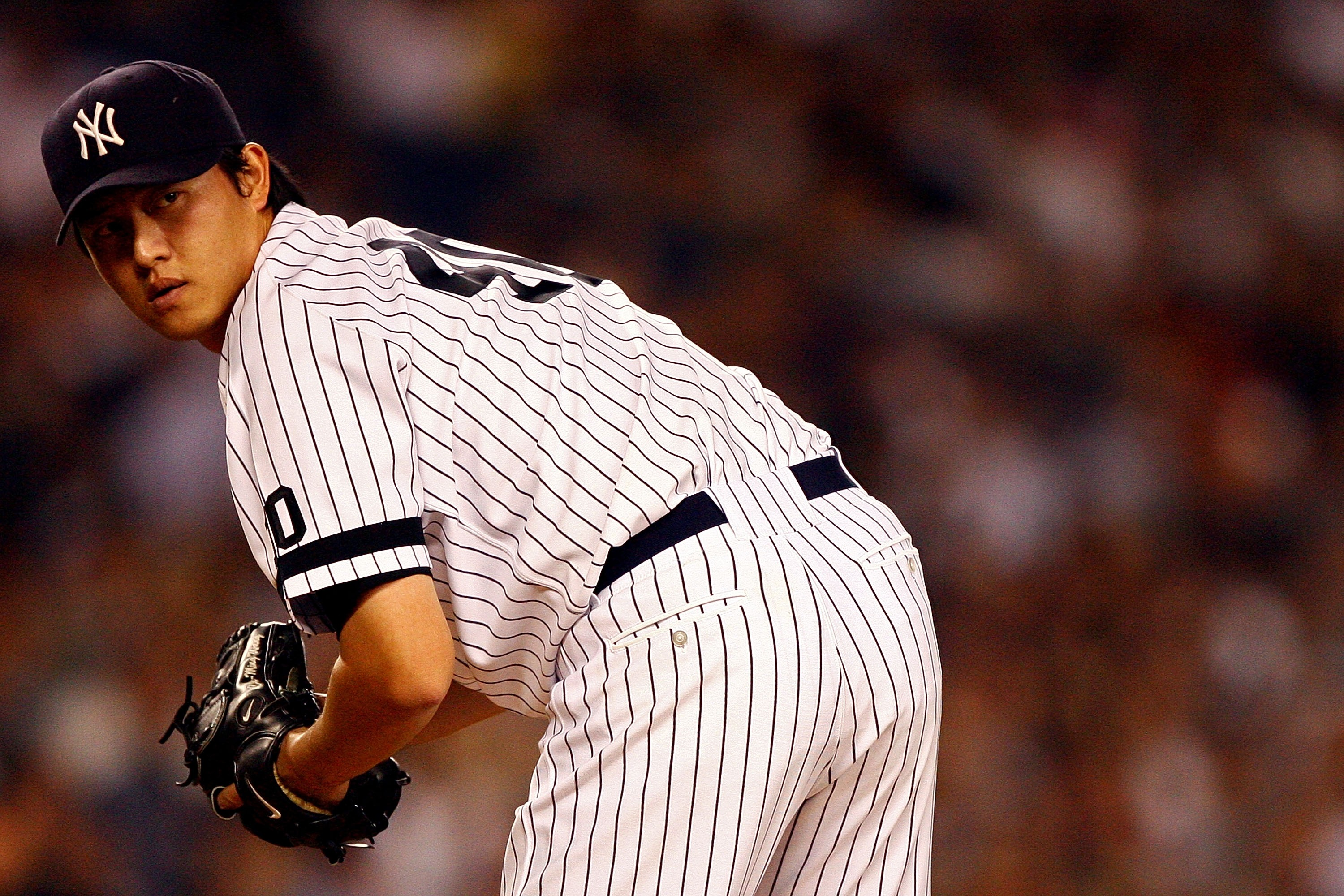 NEW YORK - OCTOBER 08:  Starting pitcher Chien-Ming Wang #40 of the New York Yankees looks to first against the Cleveland Indians during Game Four of the American League Division Series at Yankee Stadium on October 8, 2007 in the Bronx borough of New York