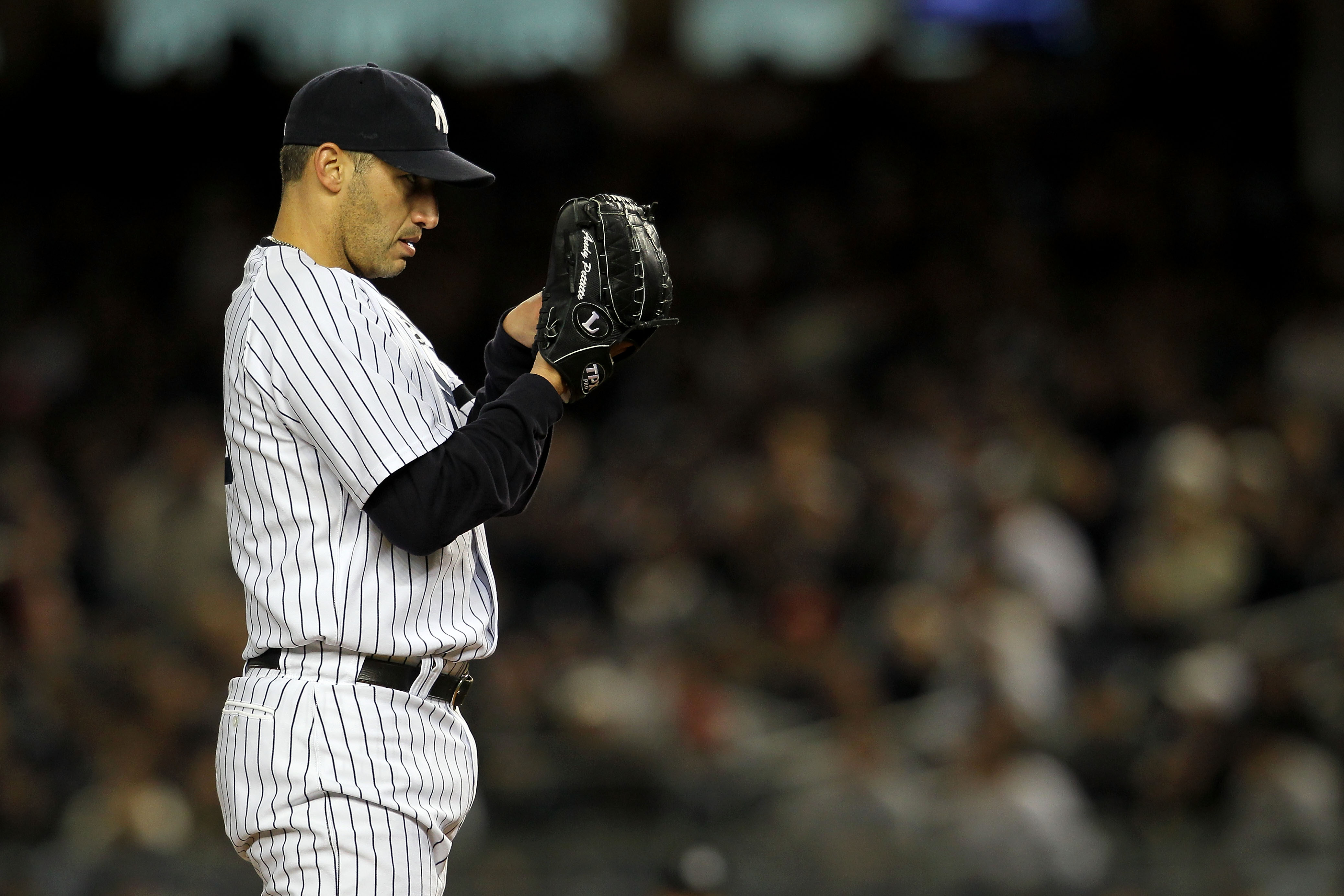 NEW YORK - OCTOBER 18:  Andy Pettitte #46 of the New York Yankees gets set to throw a pitch against the Texas Rangers in Game Three of the ALCS during the 2010 MLB Playoffs at Yankee Stadium on October 18, 2010 in New York, New York.  (Photo by Nick Laham