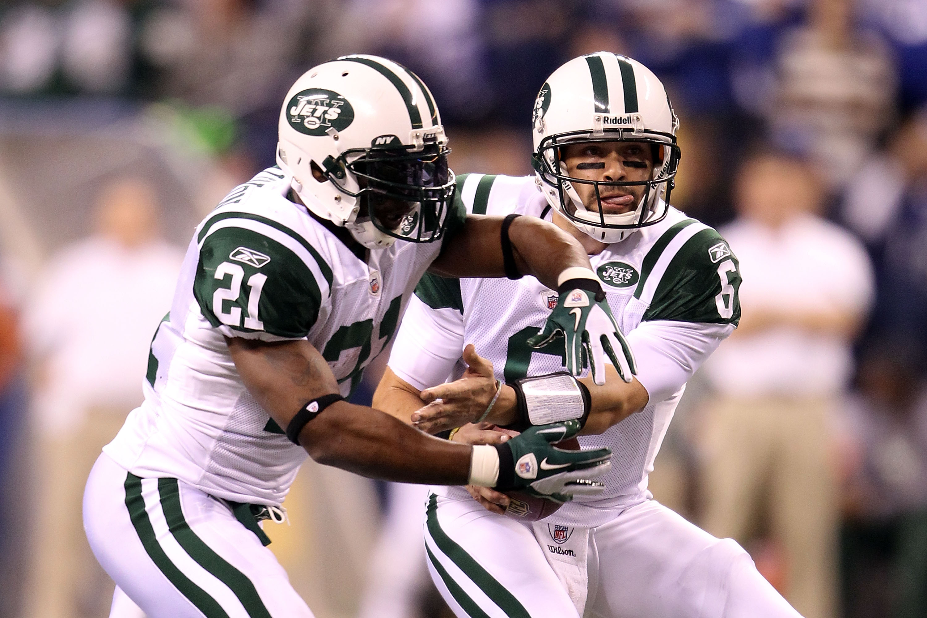 INDIANAPOLIS, IN - JANUARY 08:  Quarterback Mark Sanchez #6 of the New York Jets fakes a play action handoff to LaDainian Tomlinson #21 against the Indianapolis Colts during their 2011 AFC wild card playoff game at Lucas Oil Stadium on January 8, 2011 in