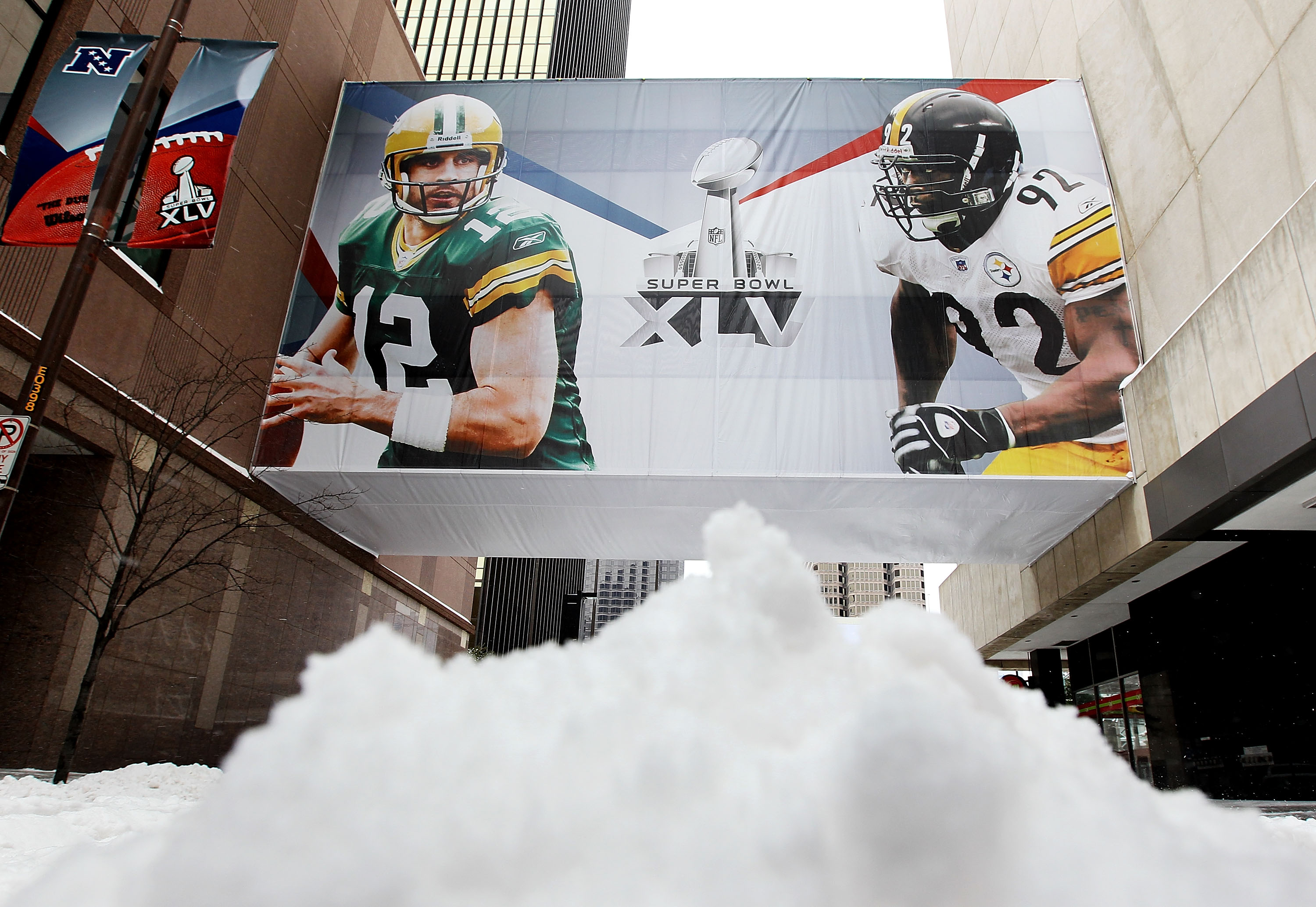DALLAS - FEBRUARY 04:  Snow is piled up on the street after a snow storm hit the Dallas area February 4, 2011 in Dallas, Texas. More than four inches of snow fell overnight in the North Texas area. The Green Bay Packers will play the Pittsburgh Steelers i